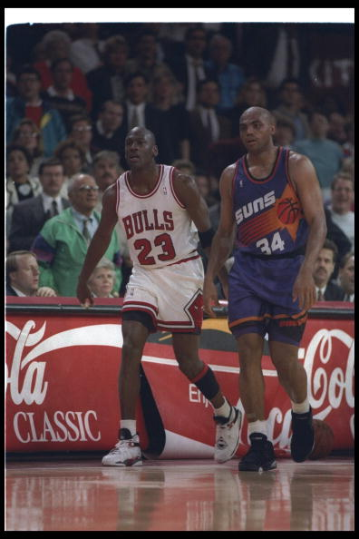 1992-1993:  Guard Michael Jordan of the Chicago Bulls (left) and forward Charles Barkley of the Phoenix Suns walk down the court during a game at the United Center in Chicago, Illinois. Mandatory Credit: Jonathan Daniel  /Allsport