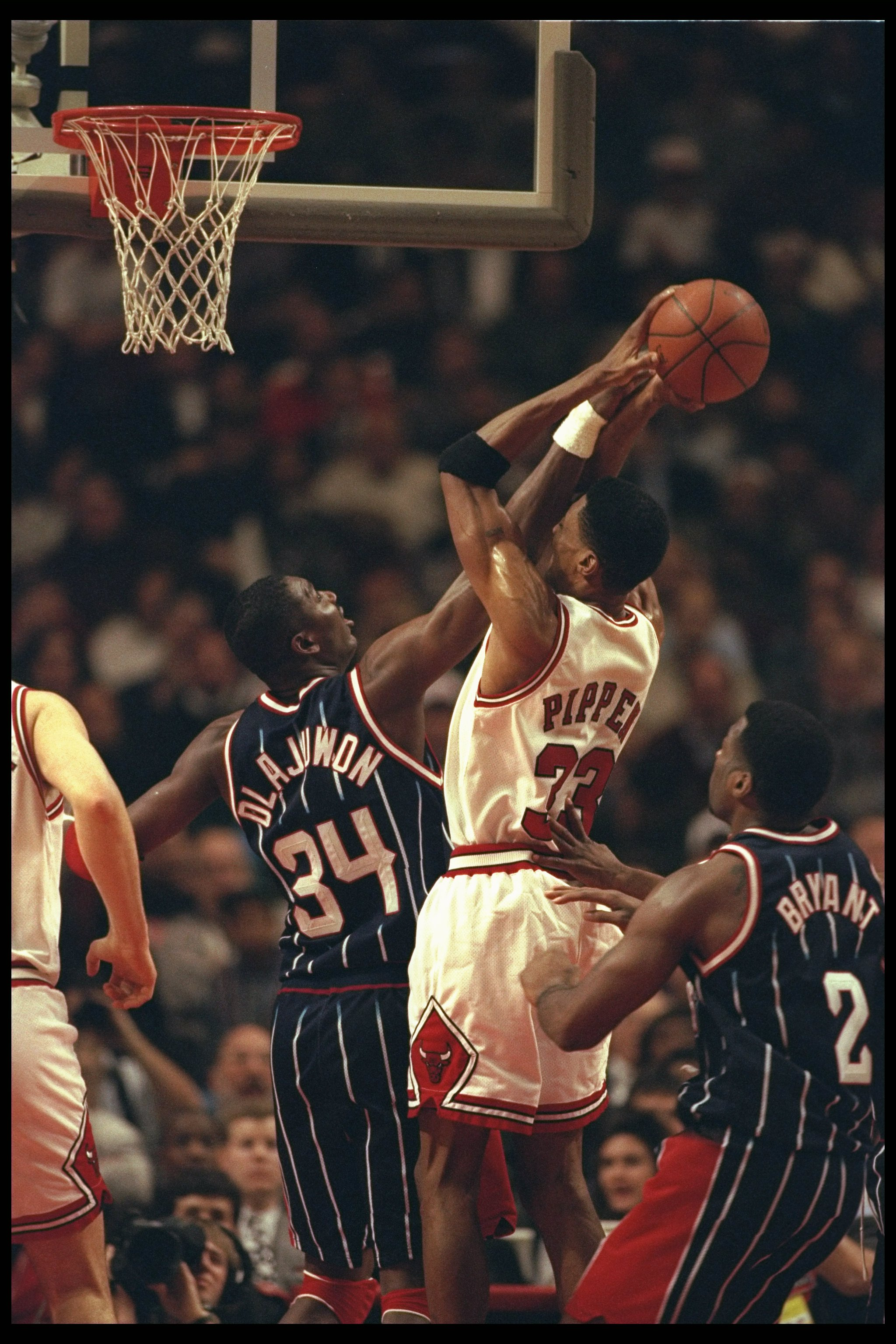 3 Jan 1996:  Center Hakeem Olajuwon of the Houston Rockets and guard Scottie Pippen of the Chicago Bulls fight for the ball during a game played at the United Center in Chicago, Illinois.  The Bulls won the game, 100-86. Mandatory Credit: Jonathan Daniel