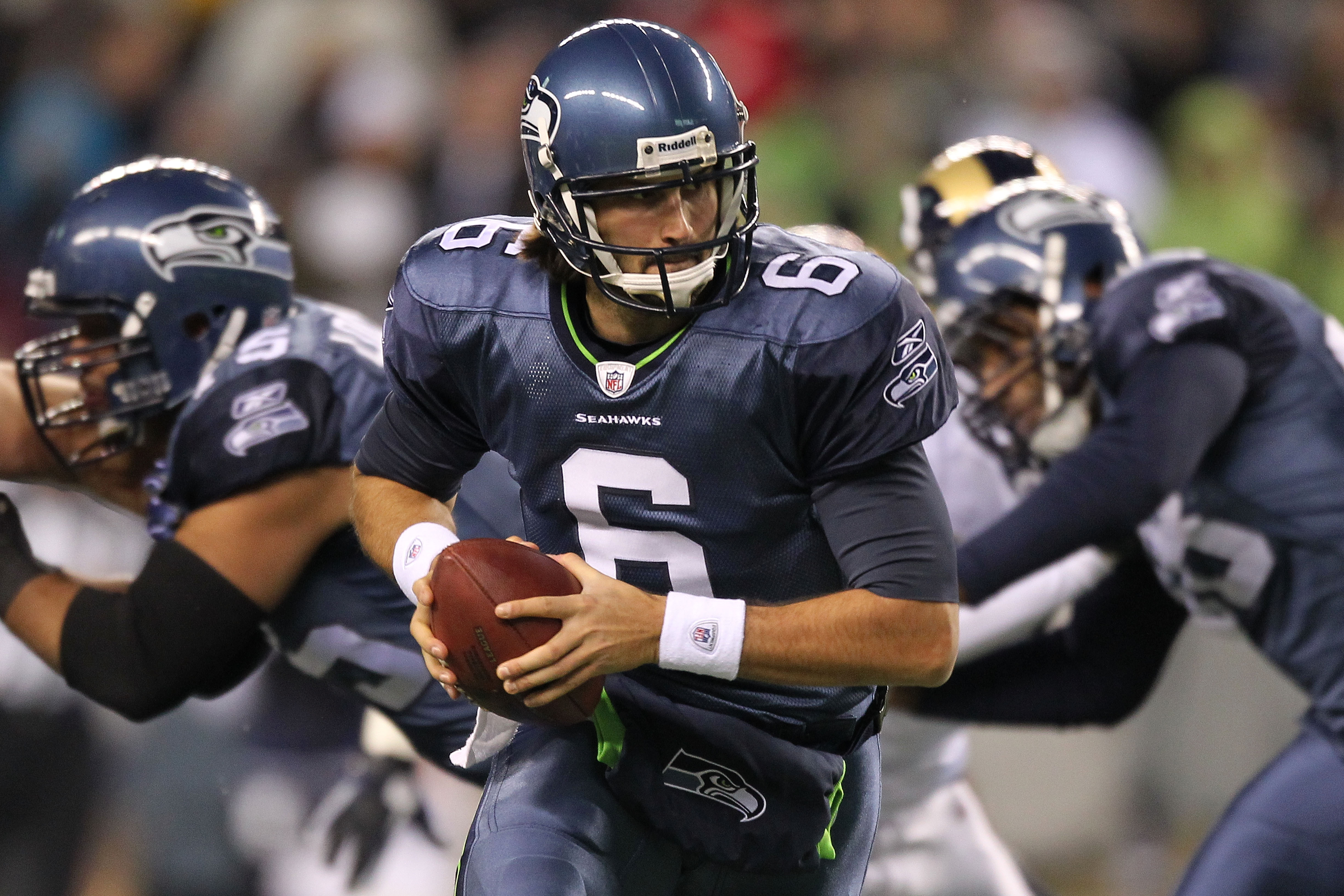 SEATTLE, WA - JANUARY 02:  Quarterback Charlie Whitehurst #6 of the Seattle Seahawks rolls out with the ball during their game against the St. Louis Rams at Qwest Field on January 2, 2011 in Seattle, Washington.  (Photo by Otto Greule Jr/Getty Images)