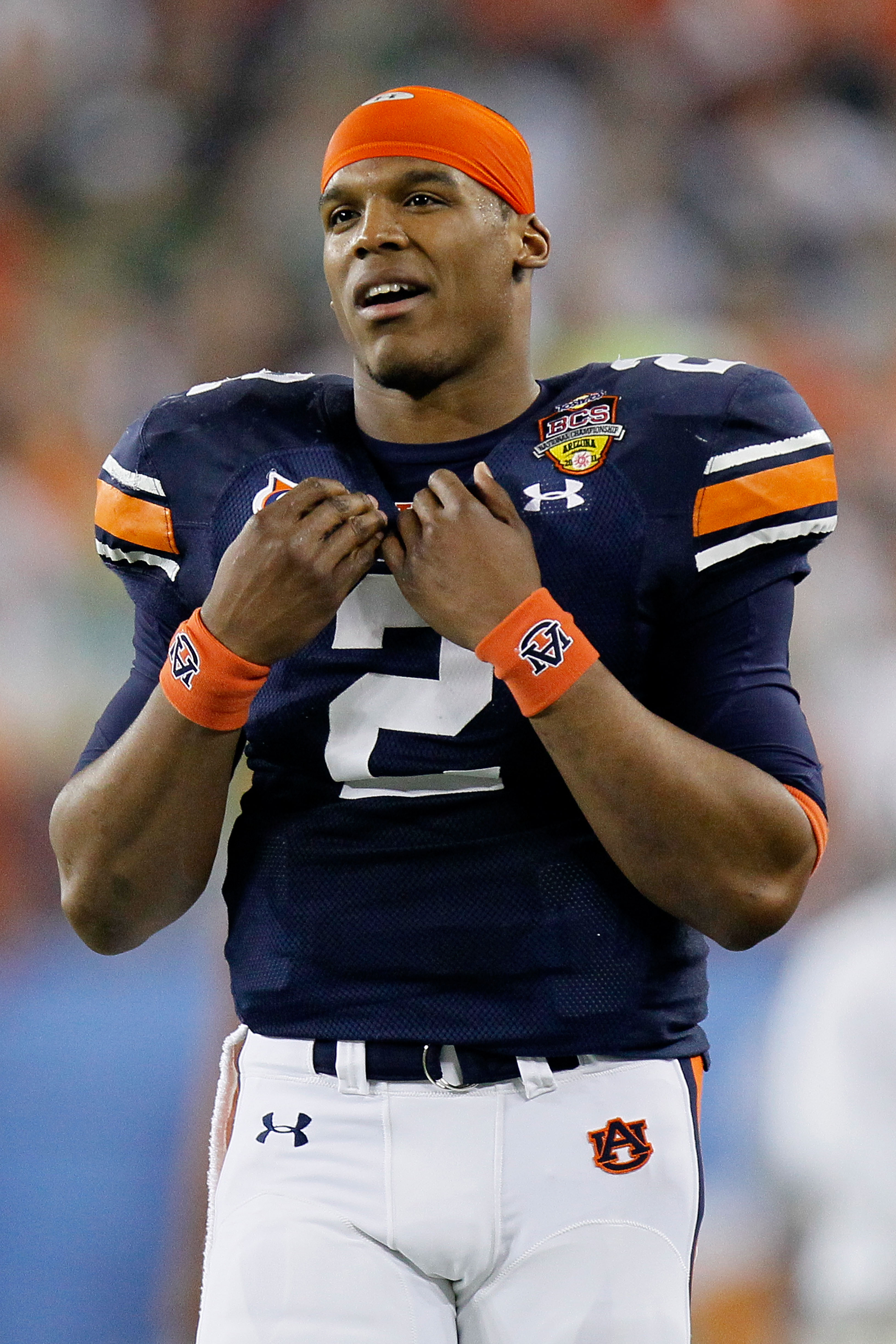 GLENDALE, AZ - JANUARY 10:  Quarterback Cameron Newton #2 of the Auburn Tigers looks on from the sideline in the first quarter against the Oregon Ducks during the Tostitos BCS National Championship Game at University of Phoenix Stadium on January 10, 2011