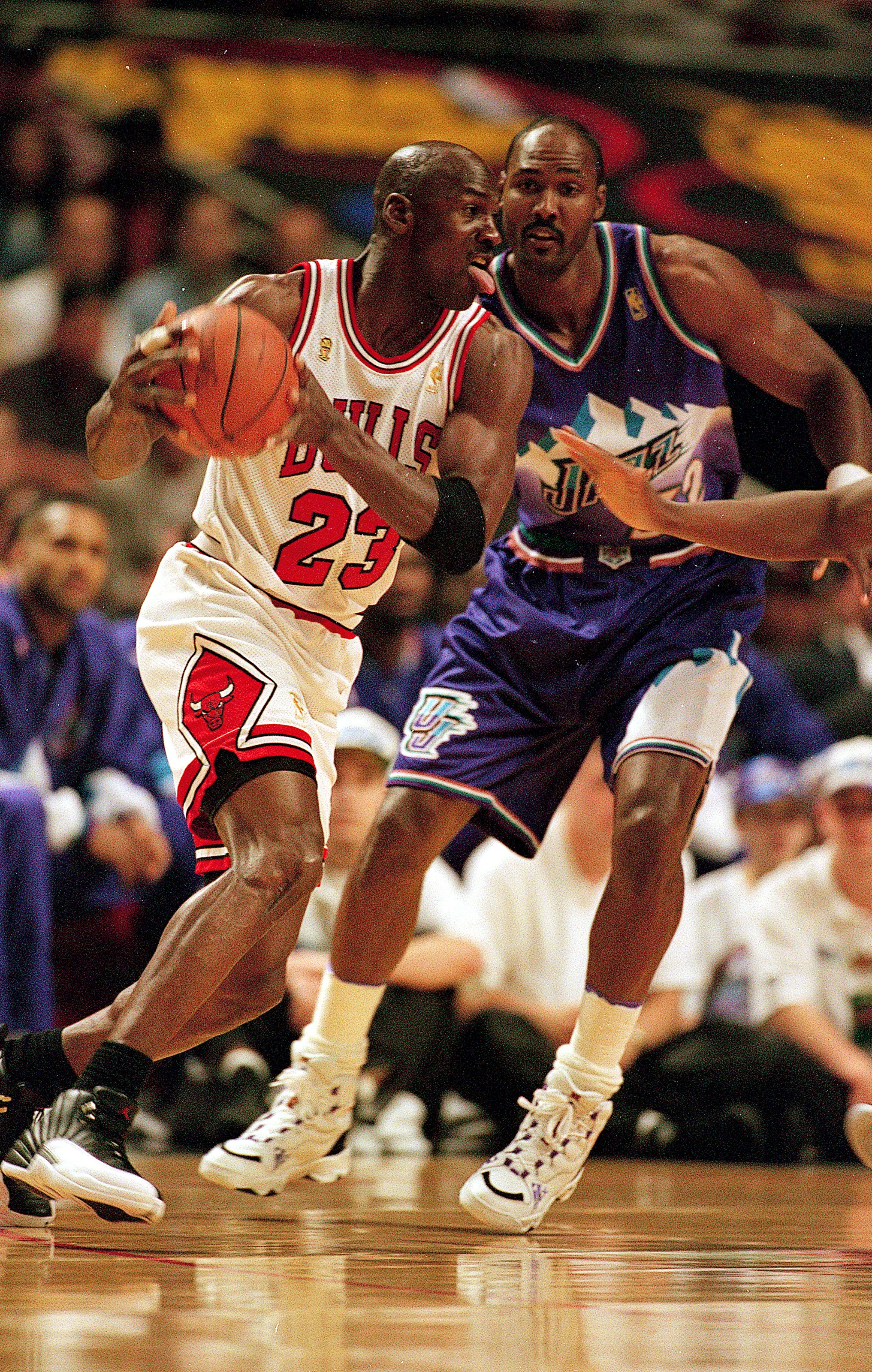 I3 Jun 1997:  Michael Jordan #23 of the Chicago Bulls dribbles the ball as he is guarded by Karl Malone #32 of the Utah Jazz during game six of the NBA Final at the United Center in Chicago, Illinois. The Bulls defeated the Jazz 90-86..   Mandatory Credit