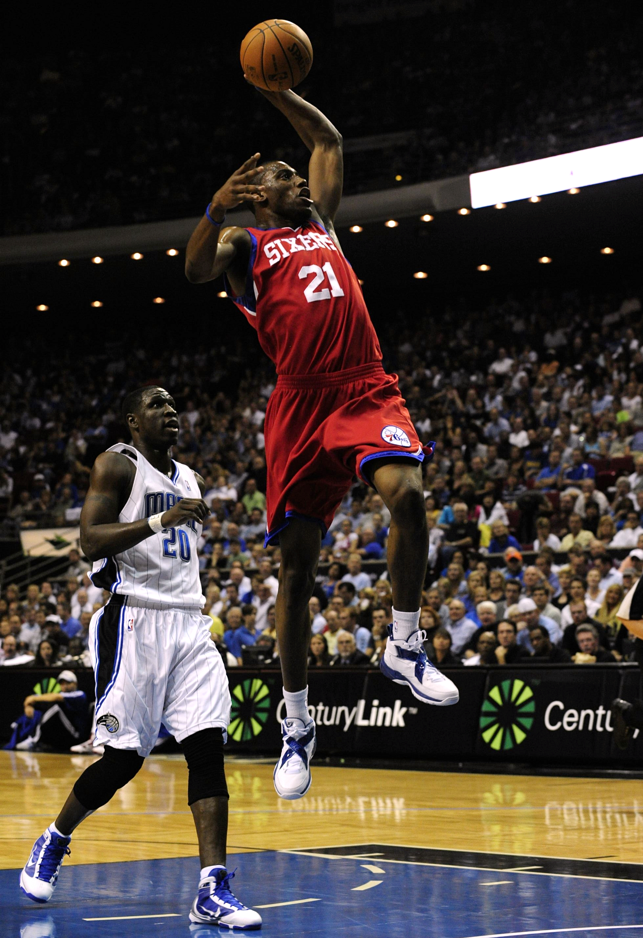 ORLANDO, FL - OCTOBER 28:  Thaddeus Young #21 of the Philadelphia 76ers goes to the basket over Mickael Pietrus #20 of the Orlando Magic during the game on October 28, 2009 at Amway Arena in Orlando, Florida.  NOTE TO USER: User expressly acknowledges and