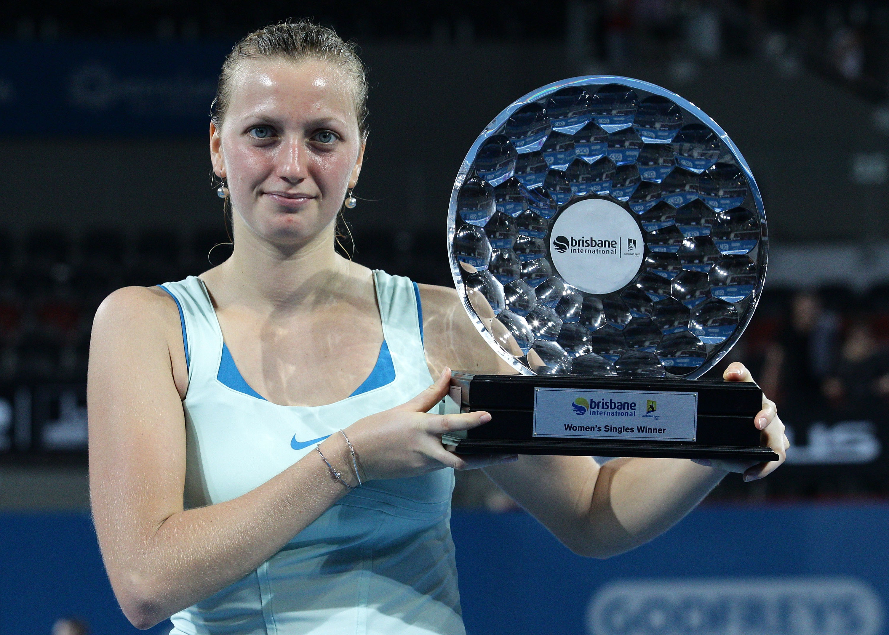 BRISBANE, AUSTRALIA - JANUARY 08:  Petra Kvitova of the Czech Republic holds the winners trophy as she celebrates victory after her finals match against Andrea Petkovic of Germany during day seven of the Brisbane International at the Queensland Tennis Cen
