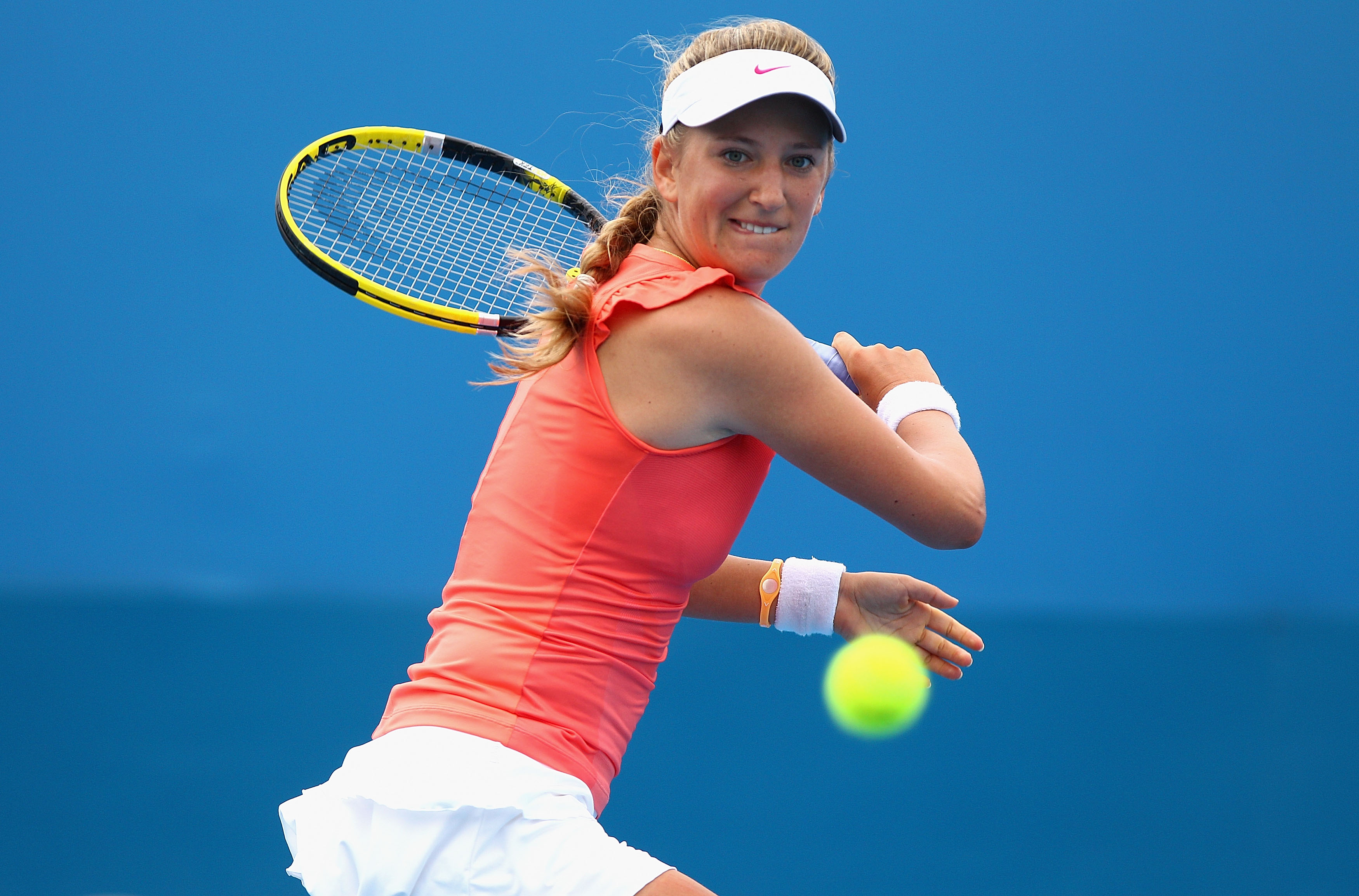 SYDNEY, AUSTRALIA - JANUARY 11: Victoria Azarenka of Belarus hits a backhand during her match against Shahar Peer of Israel during day three of the 2011 Medibank International at Sydney Olympic Park Tennis Centre on January 11, 2011 in Sydney, Australia.