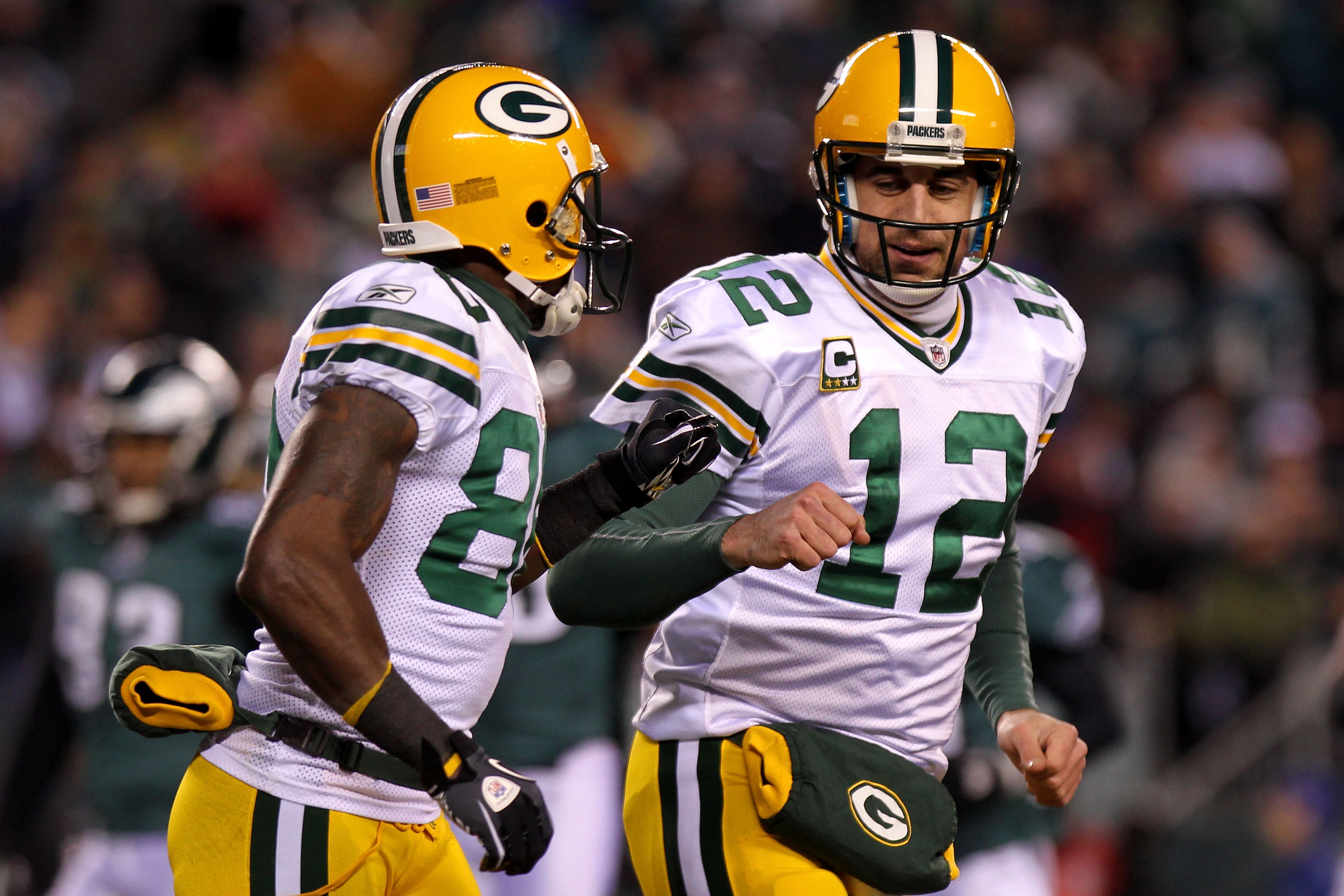 PHILADELPHIA, PA - JANUARY 09:  Aaron Rodgers #12 of the Green Bay Packers and Donald Driver #80 celebrate after a touchdown in the first quarter against the Philadelphia Eagles during the 2011 NFC wild card playoff game at Lincoln Financial Field on Janu