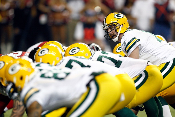 ATLANTA, GA - JANUARY 15:  Aaron Rodgers #12 of the Green Bay Packers calls signals out at the line of scrimmmage against the Atlanta Falcons during their 2011 NFC divisional playoff game at Georgia Dome on January 15, 2011 in Atlanta, Georgia.  (Photo by