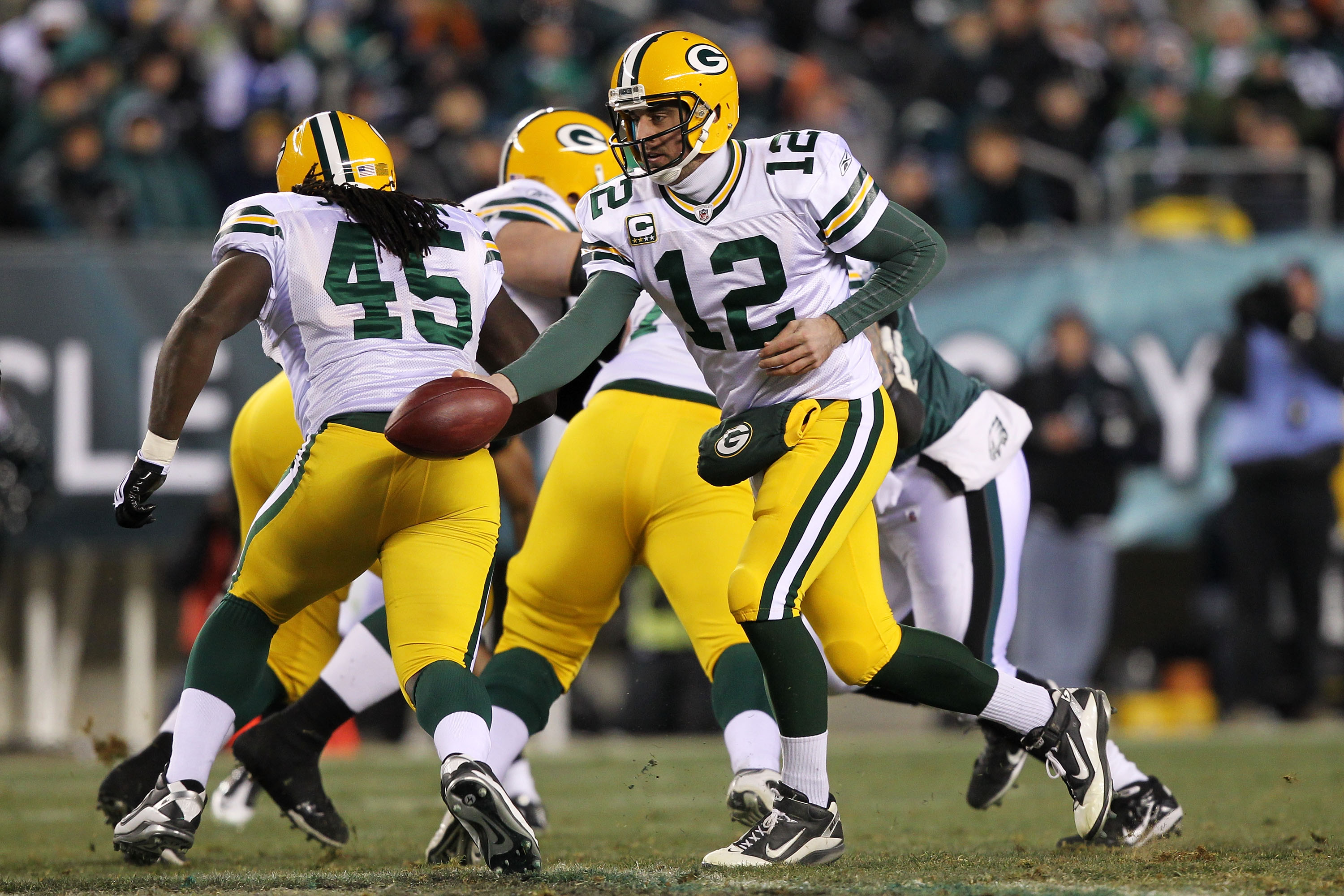 PHILADELPHIA, PA - JANUARY 09:  Aaron Rodgers #12 of the Green Bay Packers runs a play against the Philadelphia Eagles during the 2011 NFC wild card playoff game at Lincoln Financial Field on January 9, 2011 in Philadelphia, Pennsylvania.  (Photo by Al Be