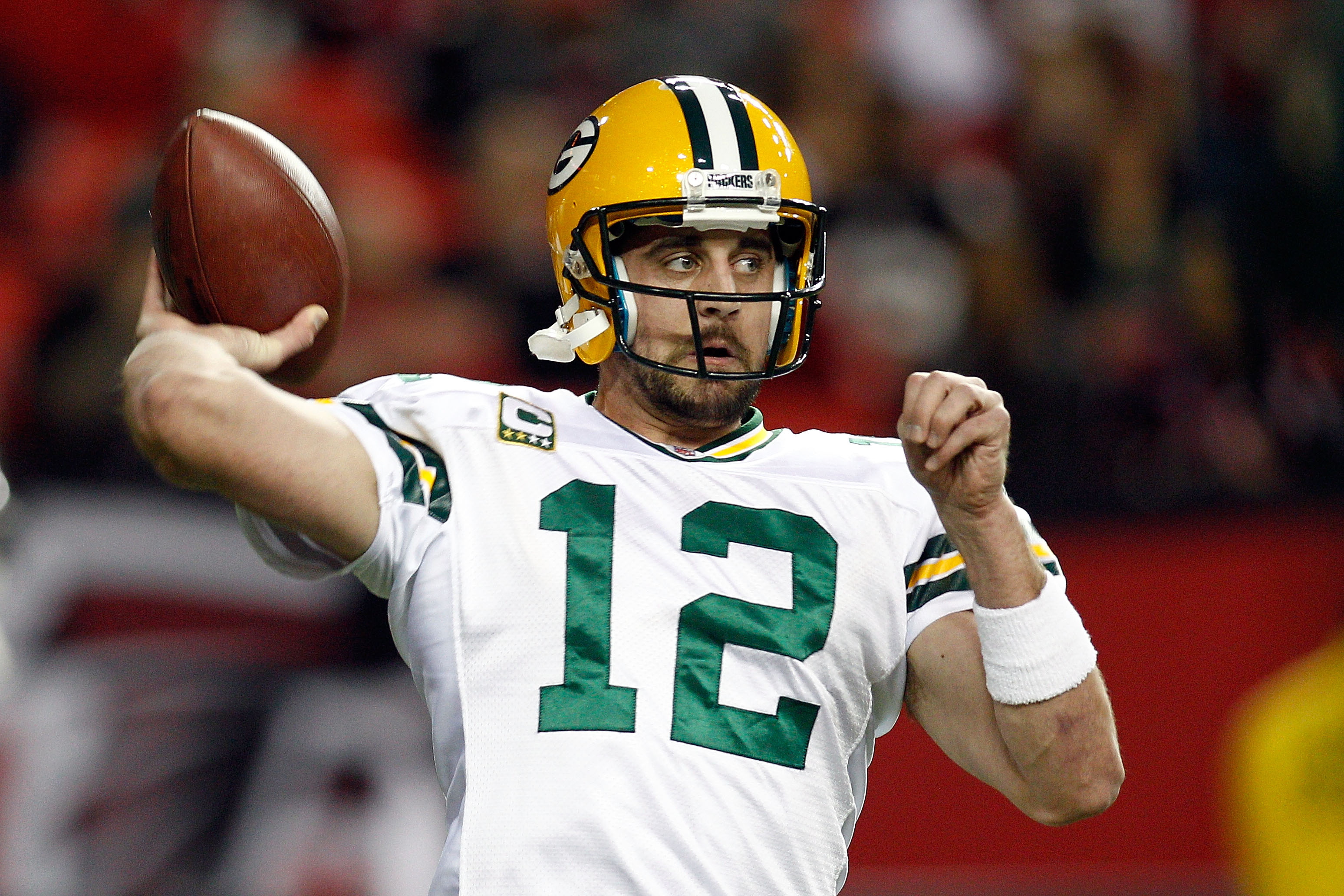 ATLANTA, GA - JANUARY 15:  Aaron Rodgers #12 of the Green Bay Packers warms up against the Atlanta Falcons during their 2011 NFC divisional playoff game at Georgia Dome on January 15, 2011 in Atlanta, Georgia.  (Photo by Chris Graythen/Getty Images)