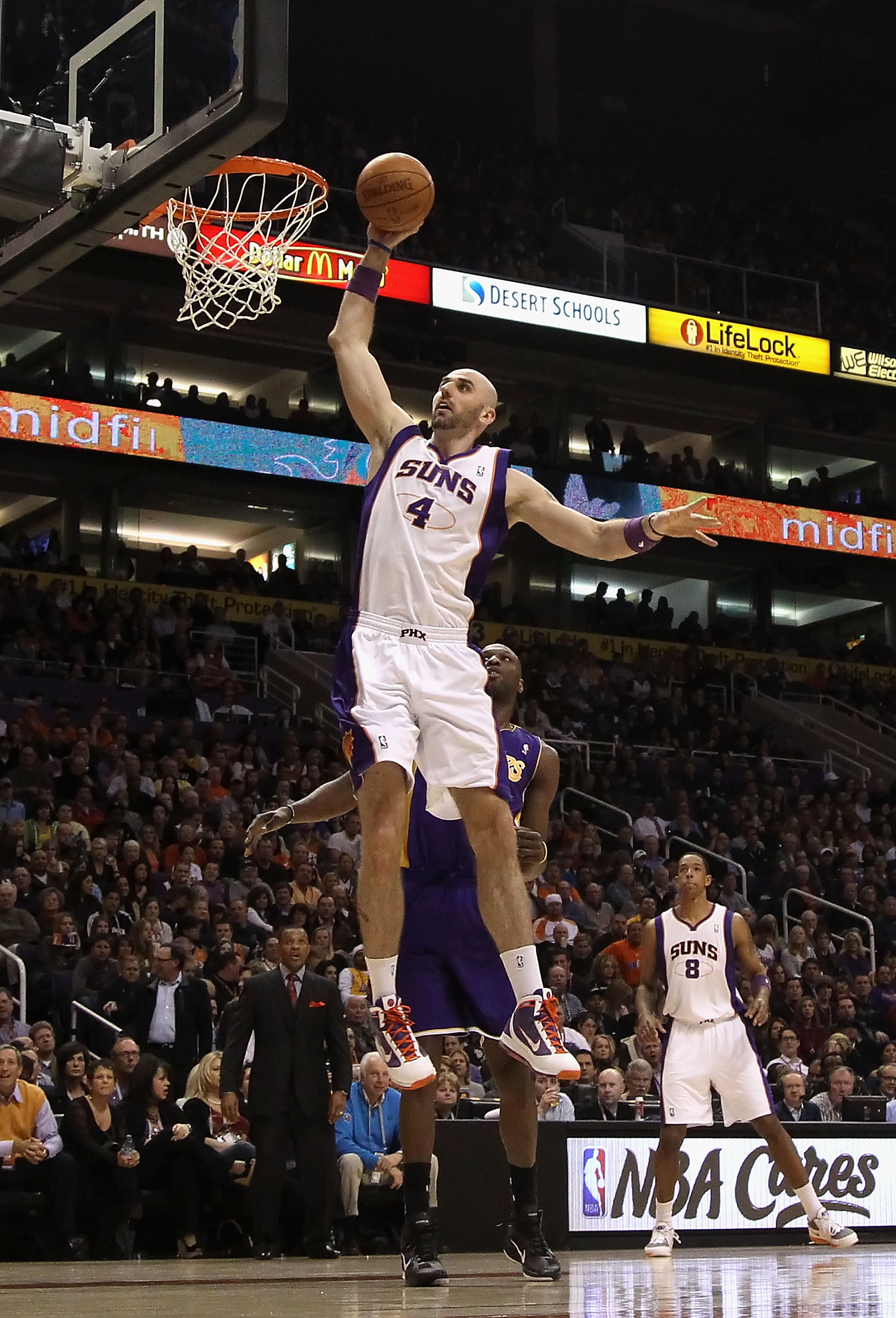 PHOENIX, AZ - JANUARY 05:  Marcin Gortat #4 of the Phoenix Suns slam dunks the ball during the NBA game against the Los Angeles Lakers at US Airways Center on January 5, 2011 in Phoenix, Arizona. The Lakers defeated the Suns 99-95.  NOTE TO USER: User exp
