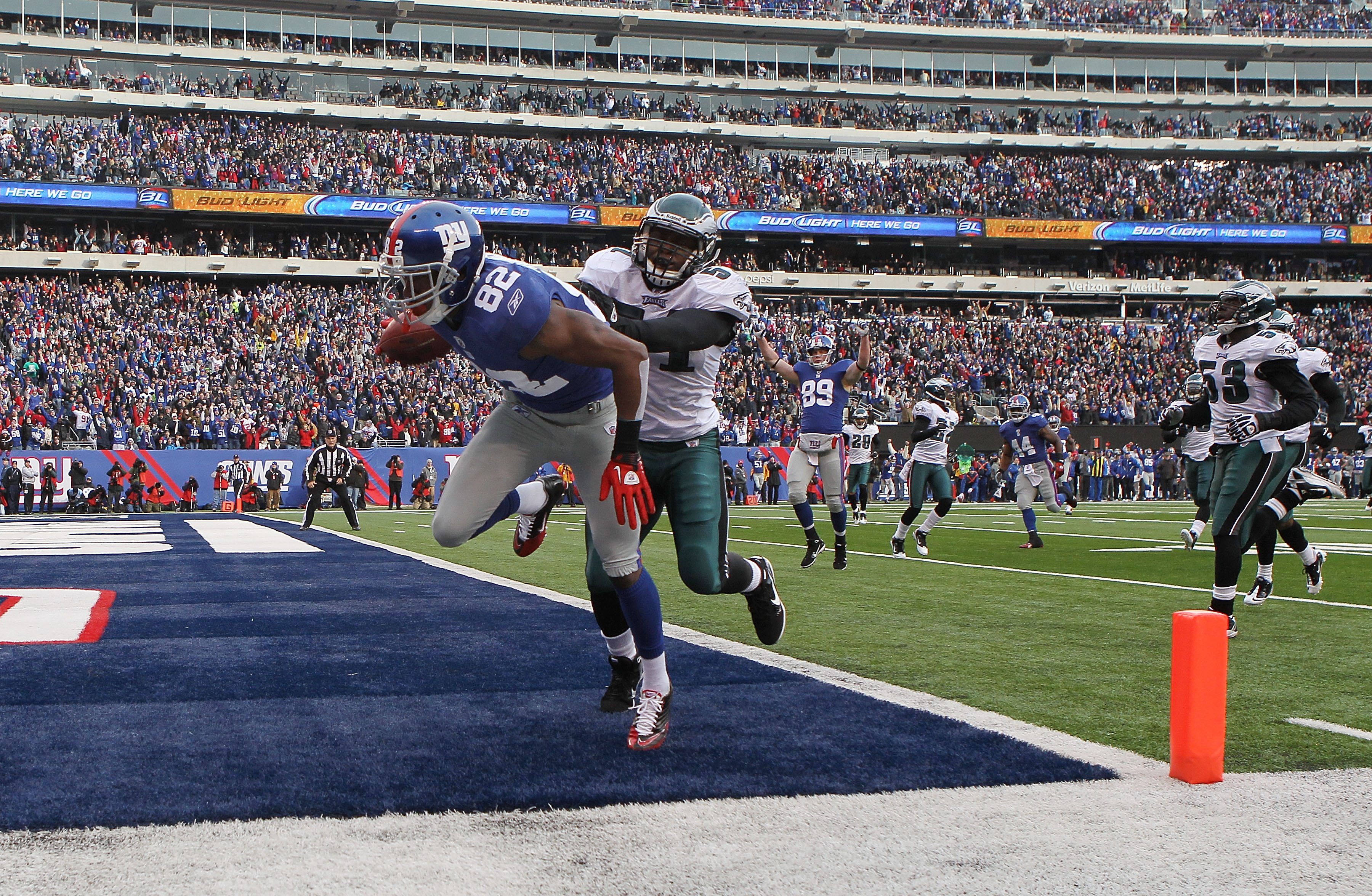 EAST RUTHERFORD, NJ - DECEMBER 19: Mario Manningham #82 of the New York Giants crosses in the corner for a touchdown against the Philadelphia Eagles at New Meadowlands Stadium on December 19, 2010 in East Rutherford, New Jersey.  (Photo by Nick Laham/Gett