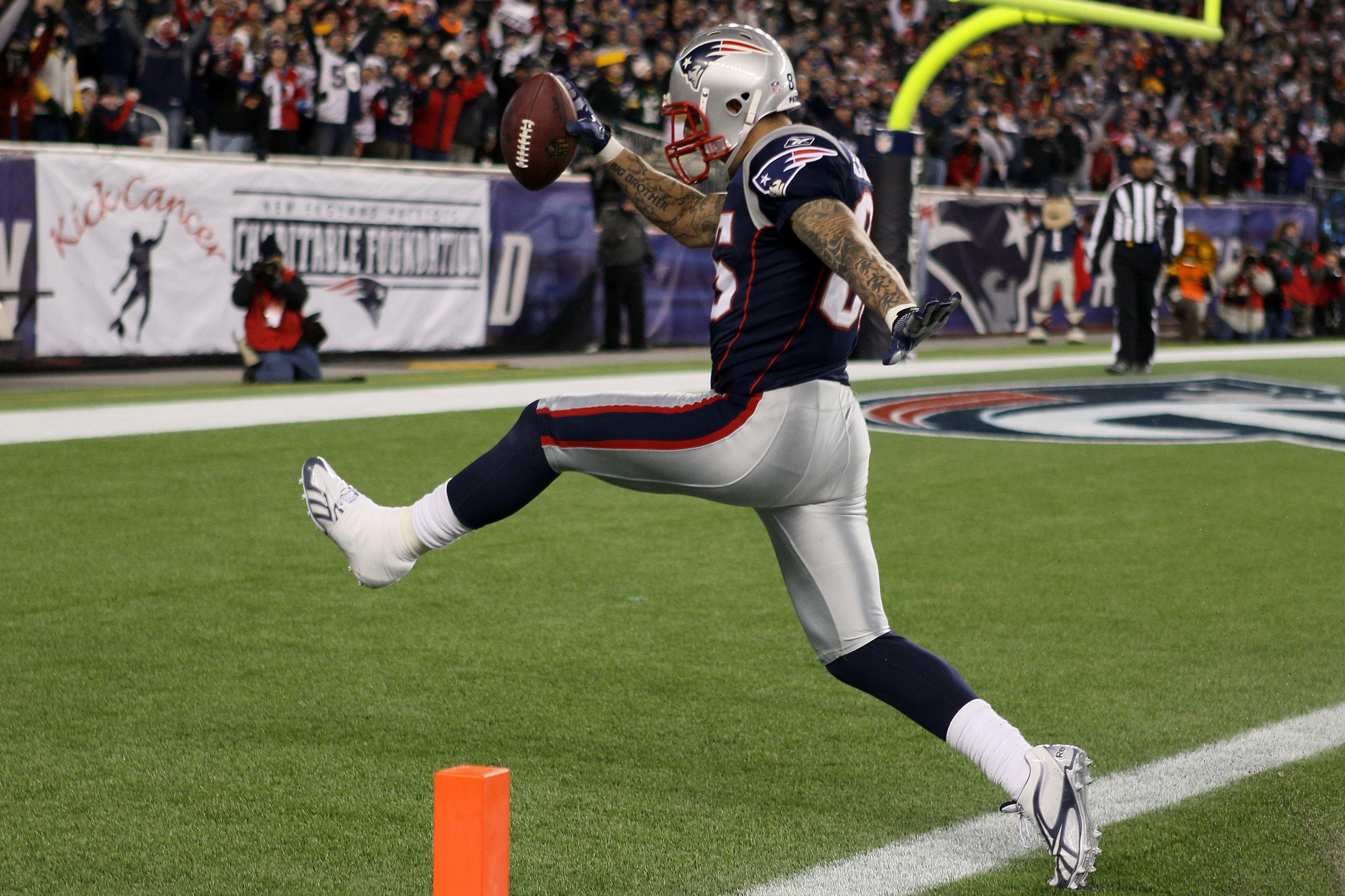 FOXBORO, MA - DECEMBER 19:  Tight end Aaron Hernandez #85 of the New England Patriots scores a touchdown after catching a pass from quarterback Tom Brady #12 (not pictured) in the fourth quarter of the game against the Green Bay Packers at Gillette Stadiu
