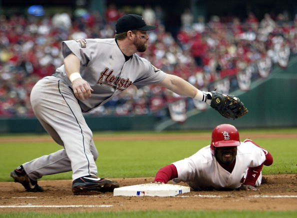 ST LOUIS - OCTOBER 20:  Tony Womack #4 of the St. Louis Cardinals dives back to first under the tag from Jeff Bagwell #5 after a pick attempt in game six of the National League Championship Series on October 20, 2004 at Busch Stadium in St. Louis, Missour