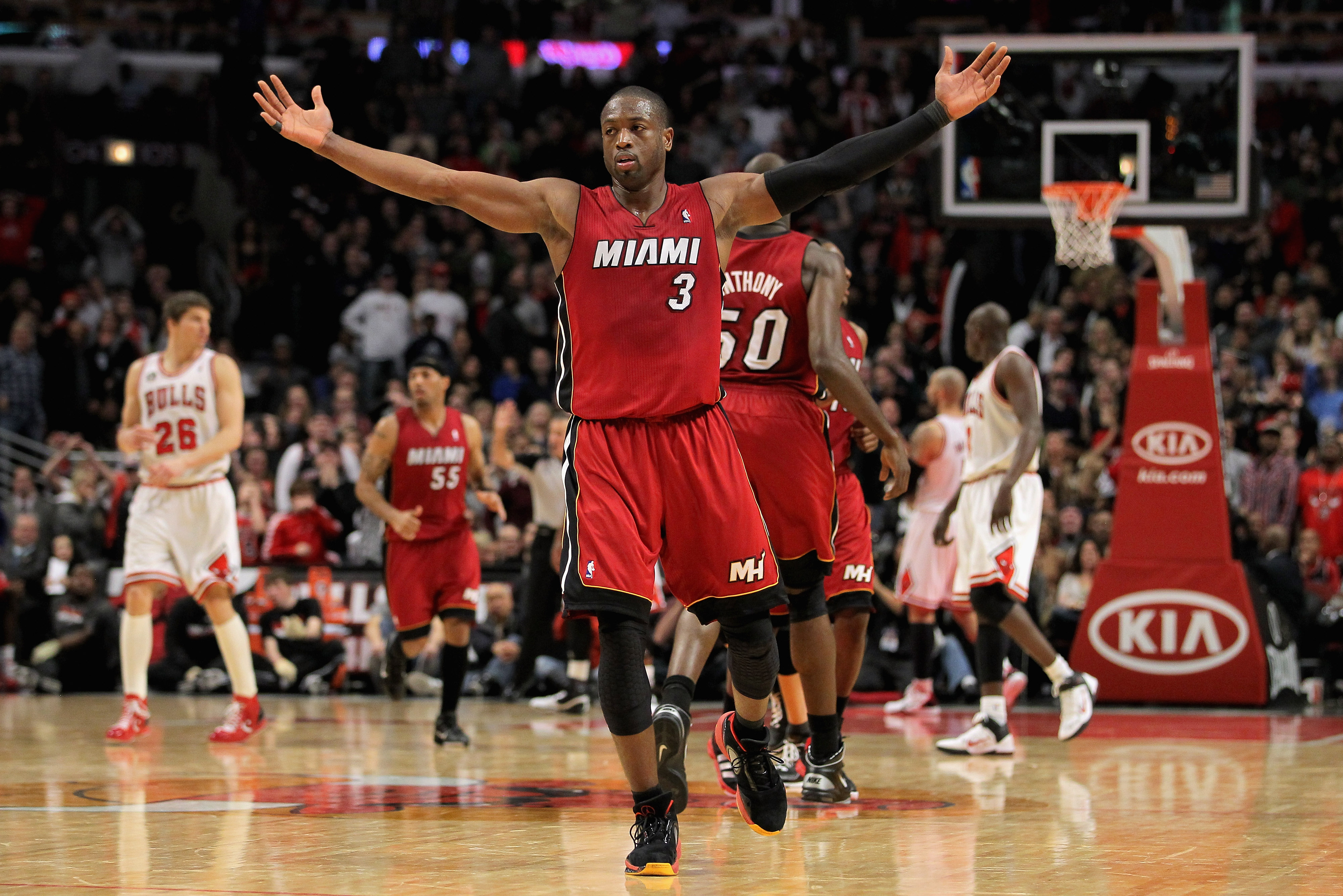CHICAGO, IL - JANUARY 15:  Dwyane Wade #3 of the Miami Heat celebrates his three point field goal with 37 seconds remaining in the game to give hte Heat a 96-95 lead over the Chicago Bulls at the United Center on January 15, 2011 in Chicago, Illinois. The