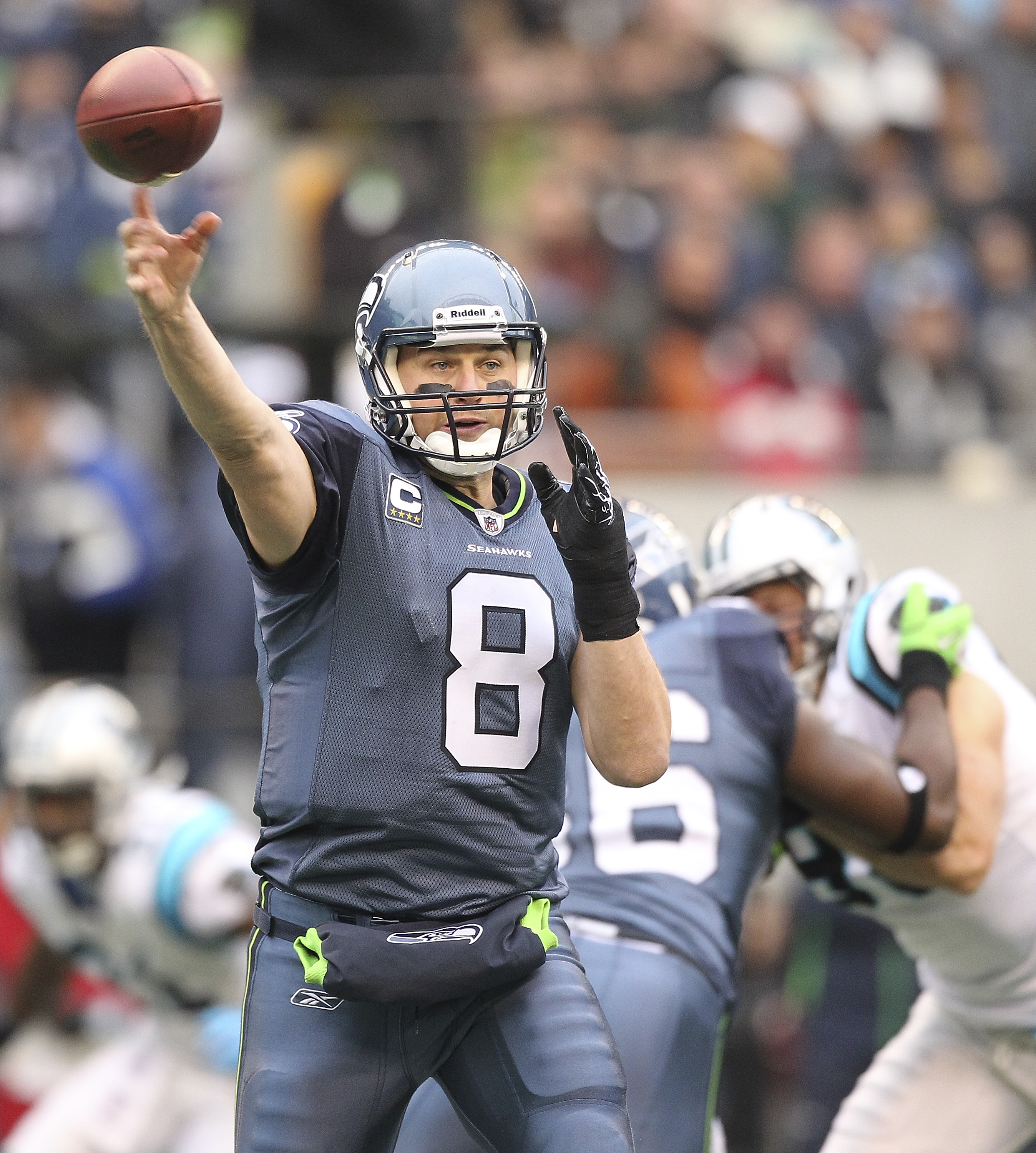 SEATTLE, WA - DECEMBER 05:  Quarterback Matt Hasselbeck #8 of the Seattle Seahawks passes against the Carolina Panthers at Qwest Field on December 5, 2010 in Seattle, Washington. (Photo by Otto Greule Jr/Getty Images)