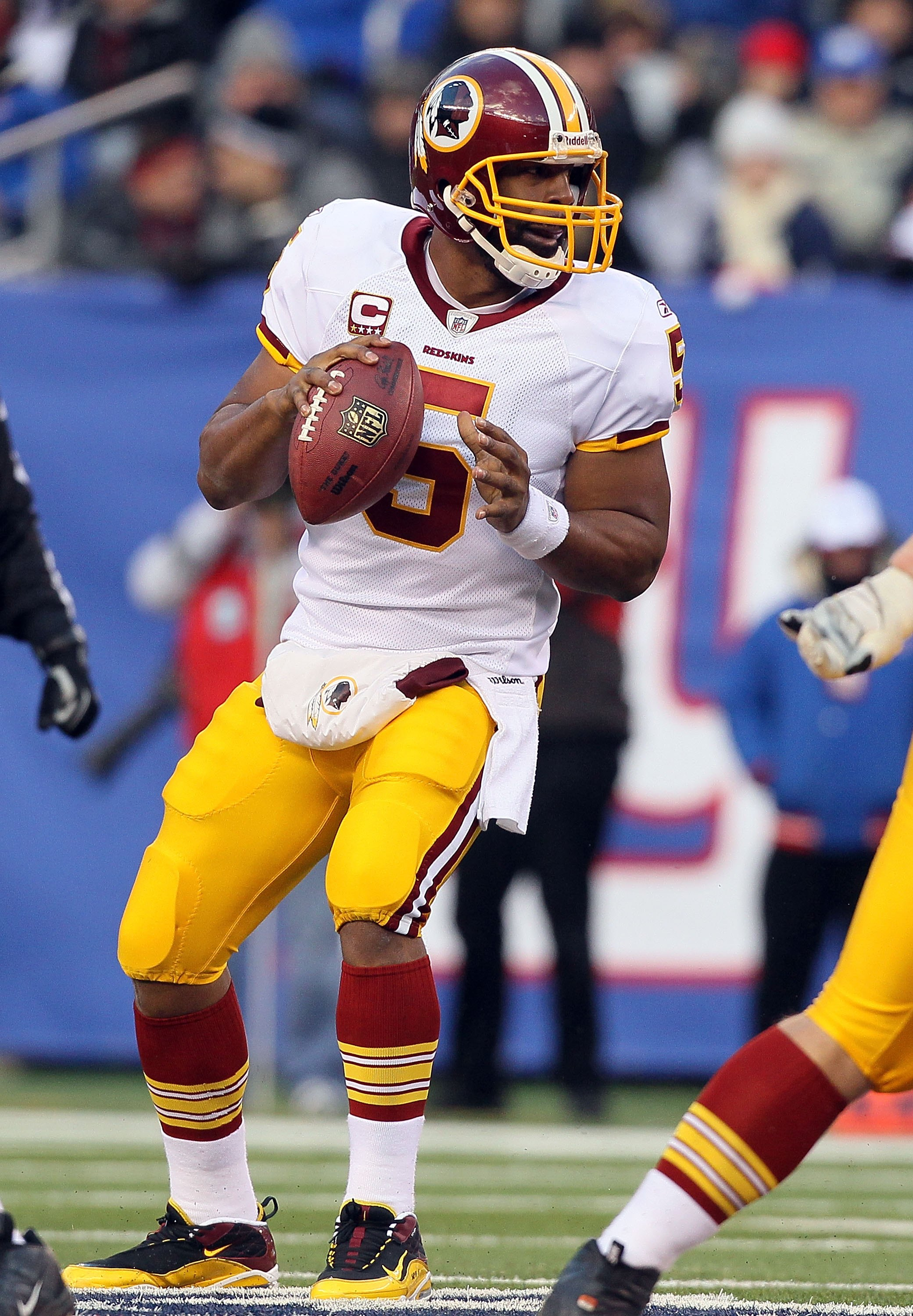 EAST RUTHERFORD, NJ - DECEMBER 05:  Donovan McNabb #5 of the Washington Redskins looks to throw a pass against the New York Giants on December 5, 2010 at the New Meadowlands Stadium in East Rutherford, New Jersey. The Giants defeated the Redskins 31-7.  (