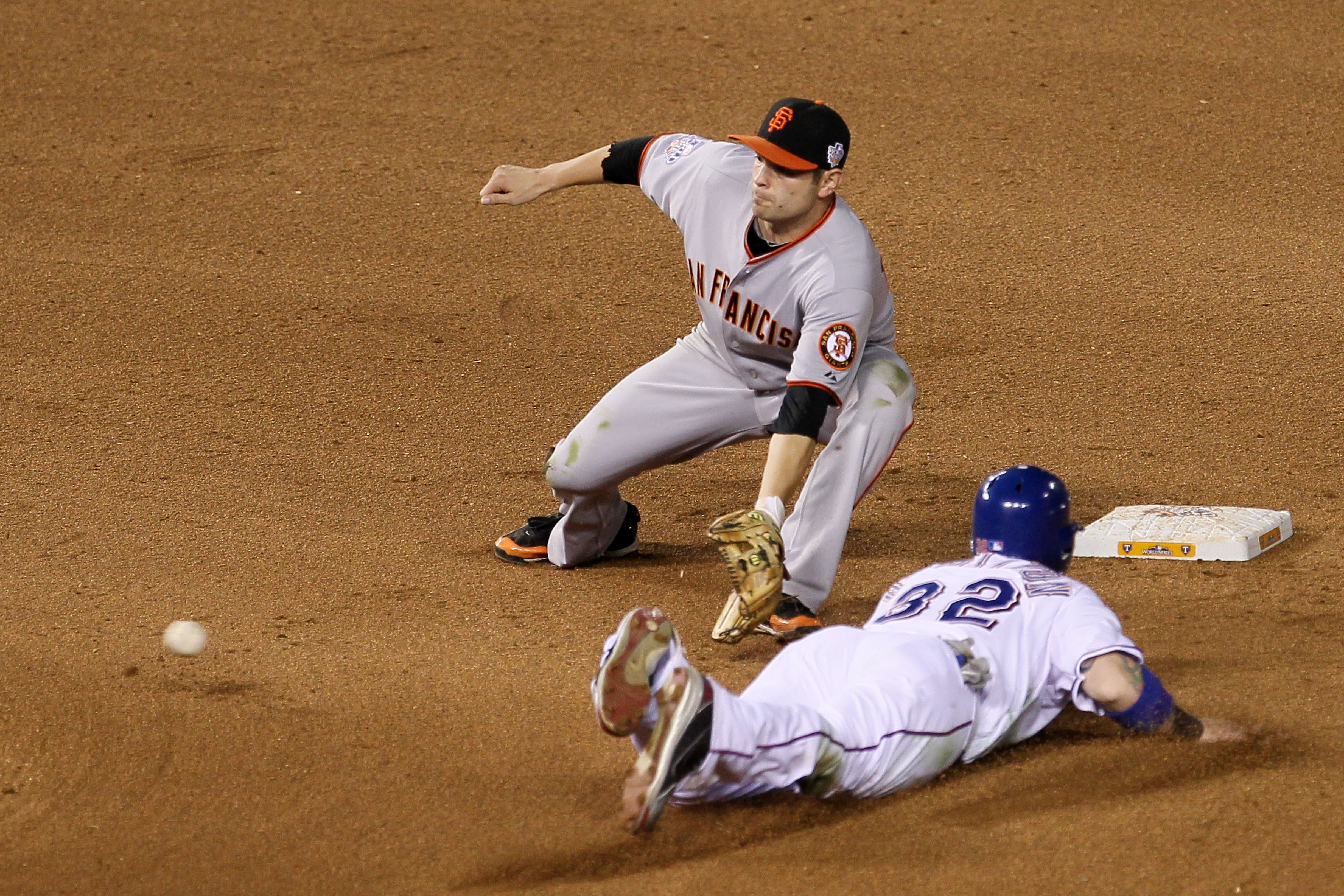 ARLINGTON, TX - OCTOBER 31:  Josh Hamilton #32 of the Texas Rangers steals second under the tag from Freddy Sanchez #21 of the San Francisco Giants in Game Four of the 2010 MLB World Series at Rangers Ballpark in Arlington on October 31, 2010 in Arlington