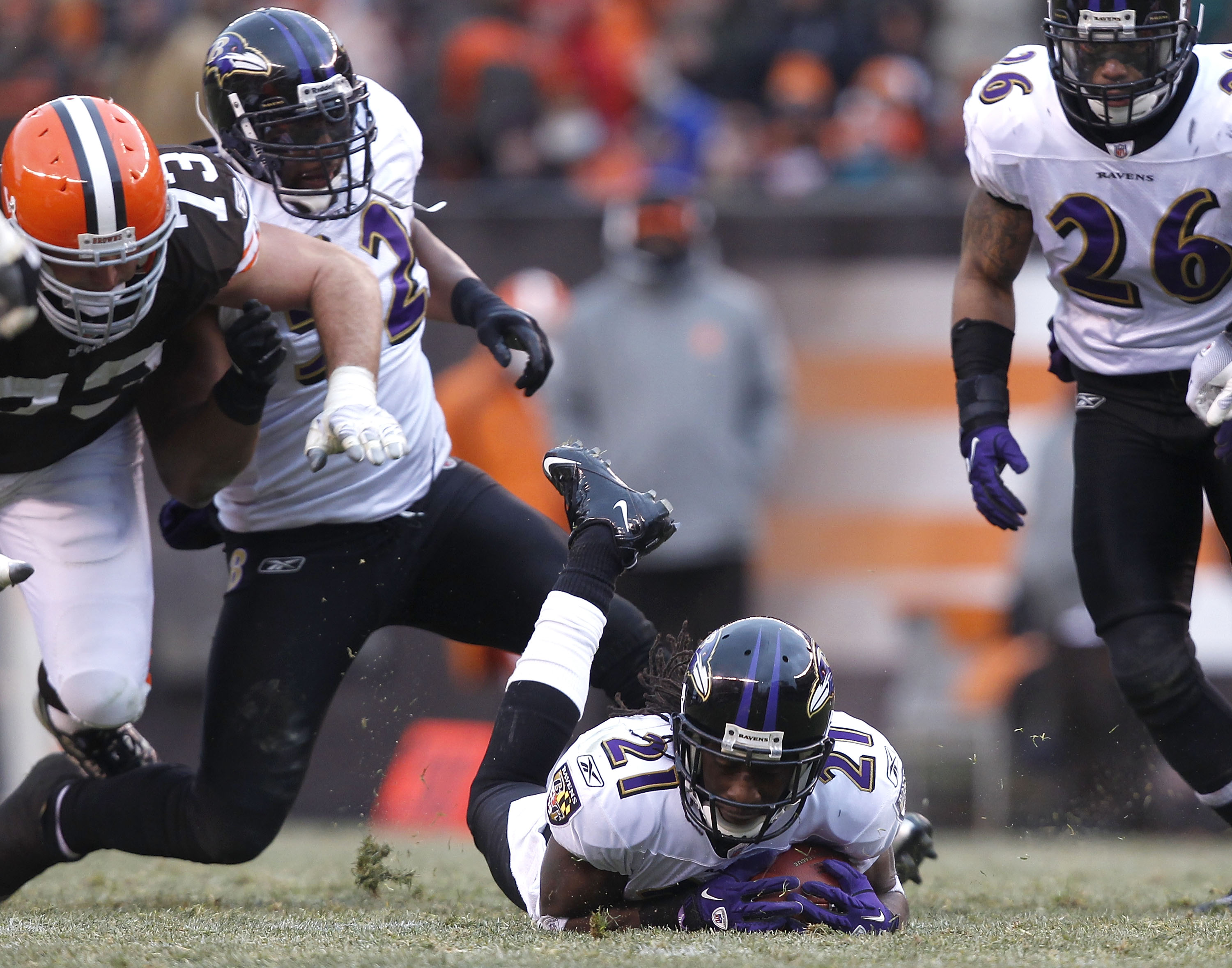 CLEVELAND - DECEMBER 26:  Cornerback Lardarius Webb #21 of the Baltimore Ravens recovers a fumble as Ray Lewis #52, Dawan Landry #26 and lineman Joe Thomas #73 of the Cleveland Browns look on at Cleveland Browns Stadium on December 26, 2010 in Cleveland,