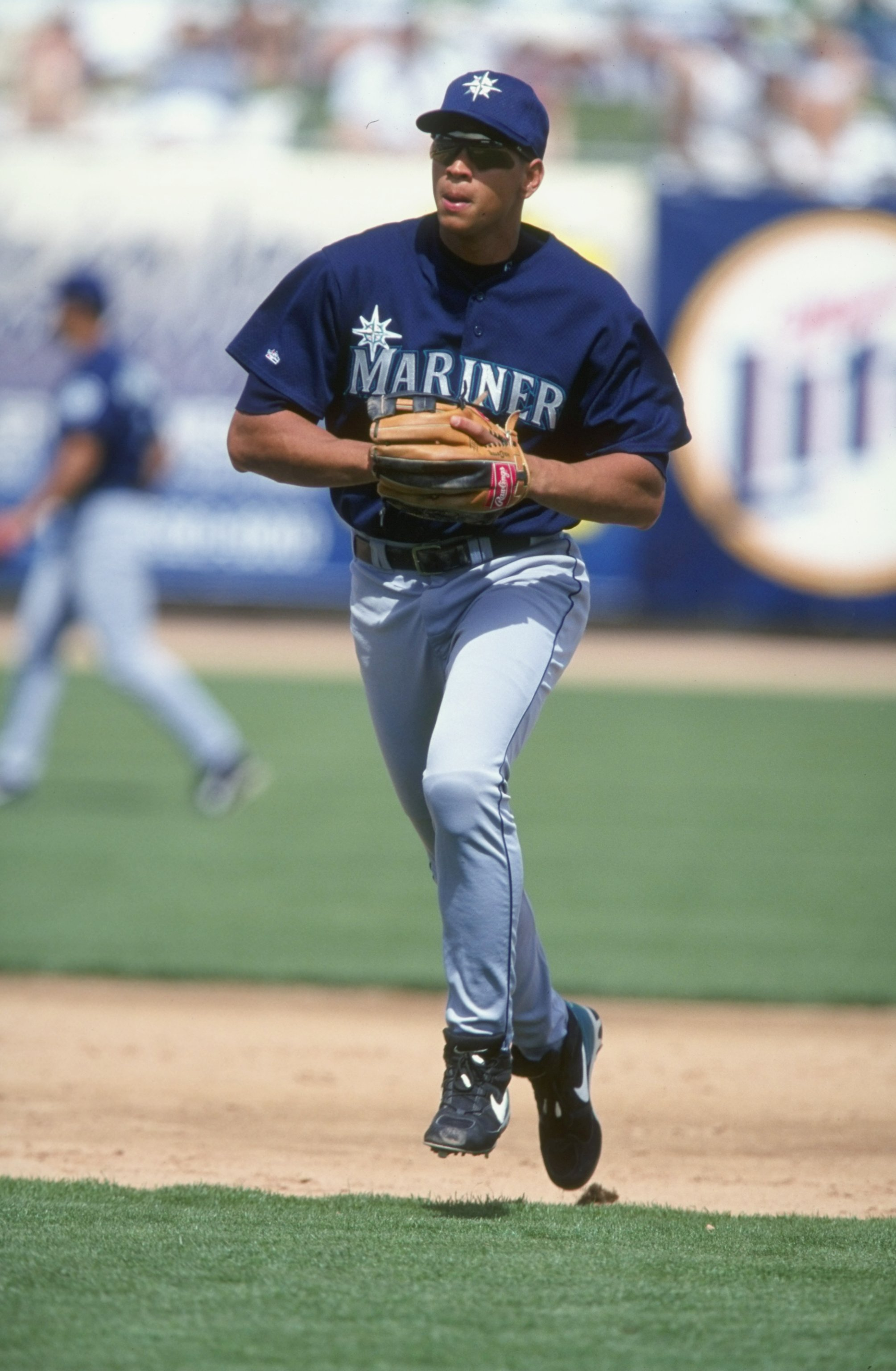 14 Mar 1999:  Infielder Alex Rodriguez #3 of the Seattle Mariners runs off the field during the Spring Training game against the Chicago Cubs at the HoHoKam Park in Mesa, Arizona. The Mariners defeated the Cubs 8-7. Mandatory Credit: Tom Hauck  /Allsport
