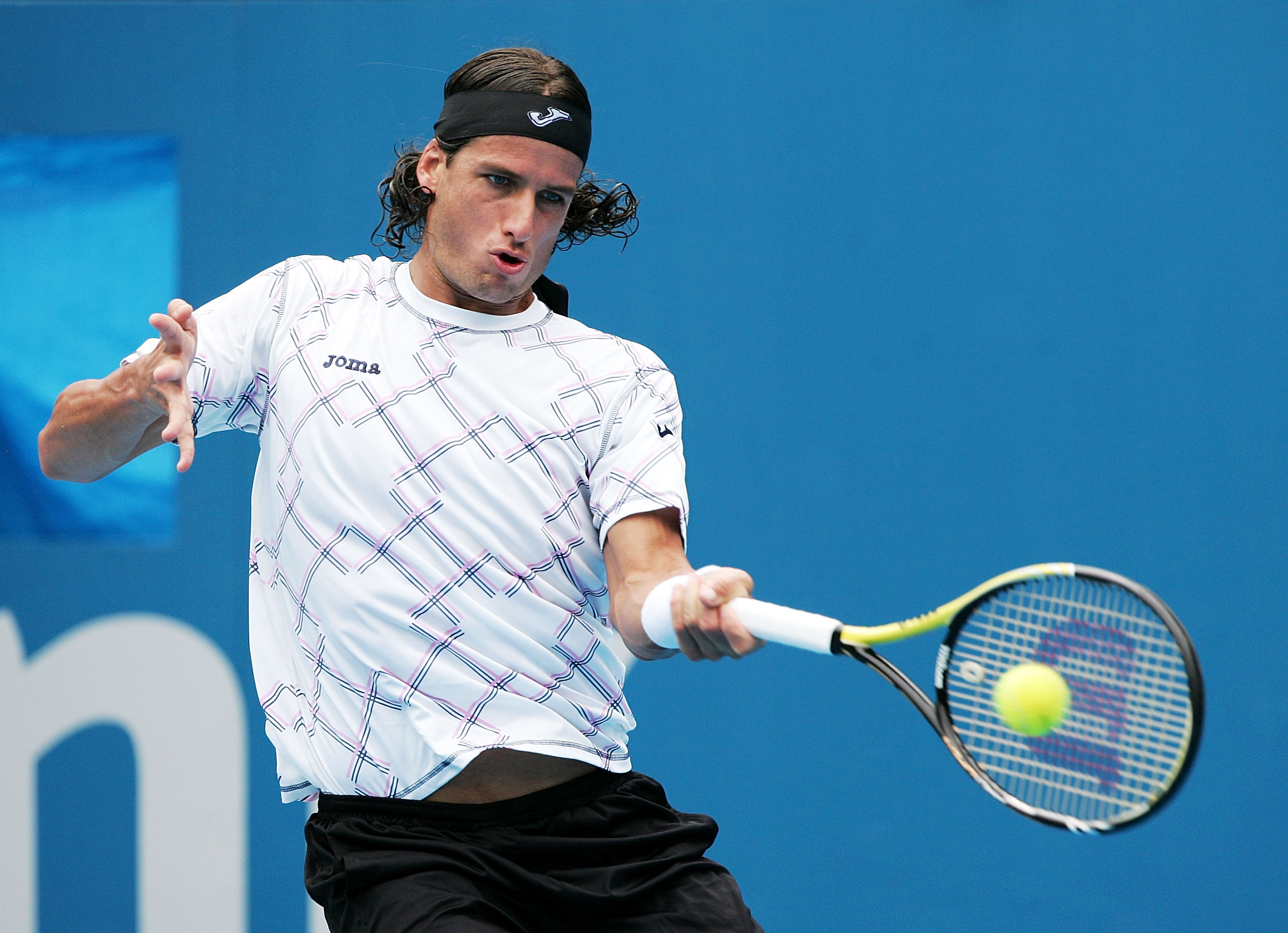 SYDNEY, AUSTRALIA - JANUARY 10:  Feliciano Lopez of Spain plays a forehand in his/her match against Juan Martin Del Potro of Argentina during day two of the 2011 Medibank International at Sydney Olympic Park Tennis Centre on January 10, 2011 in Sydney, Au