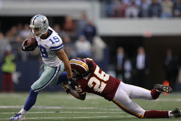 ARLINGTON, TX - DECEMBER 19:  Wide receiver Miles Austin #19 of the Dallas Cowboys runs the ball against Kevin Barnes #25 of the Washington Redskins at Cowboys Stadium on December 19, 2010 in Arlington, Texas.  (Photo by Ronald Martinez/Getty Images)