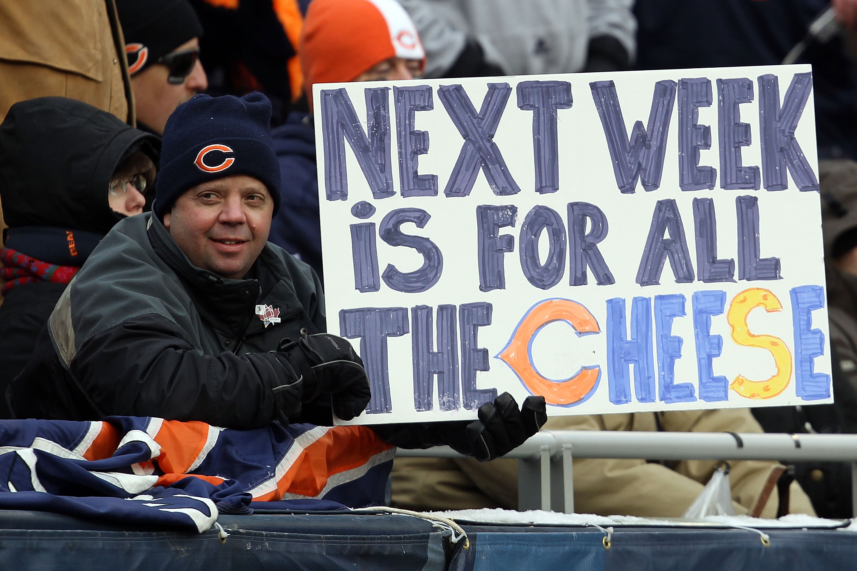 CHICAGO, IL - JANUARY 16:  A Chicago Bears fan holds up a sign previewing next week's NFC championship game between the Bears and the Green Bay Packers at Soldier Field on January 16, 2011 in Chicago, Illinois.  (Photo by Jonathan Daniel/Getty Images)