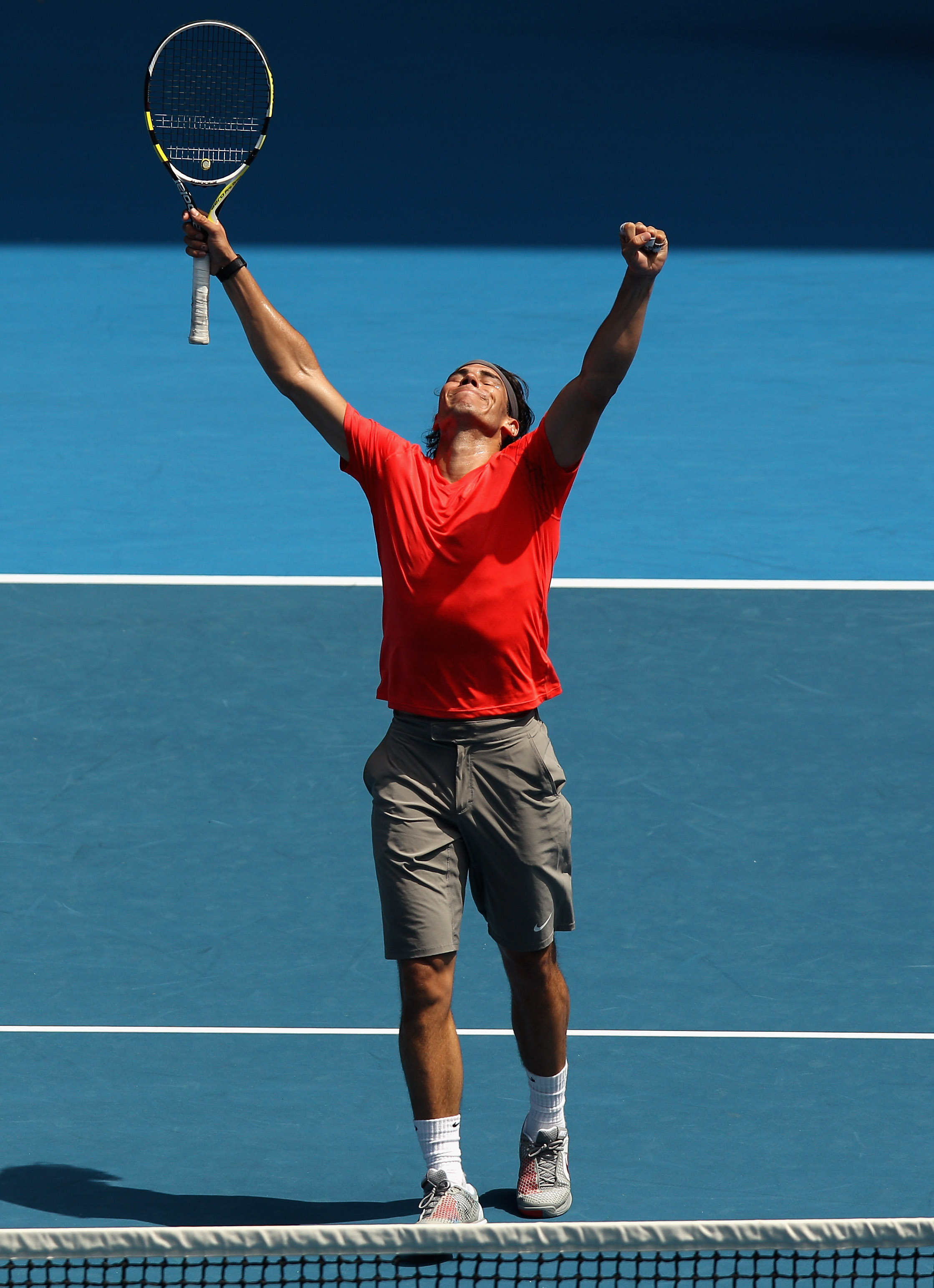 MELBOURNE, AUSTRALIA - JANUARY 16:  Rafael Nadal of Spaincelebrates a point during the 'Rally For Relief' charity exhibition match ahead of the 2011 Australian Open at Melbourne Park on January 16, 2011 in Melbourne, Australia.  (Photo by Mark Dadswell/Ge