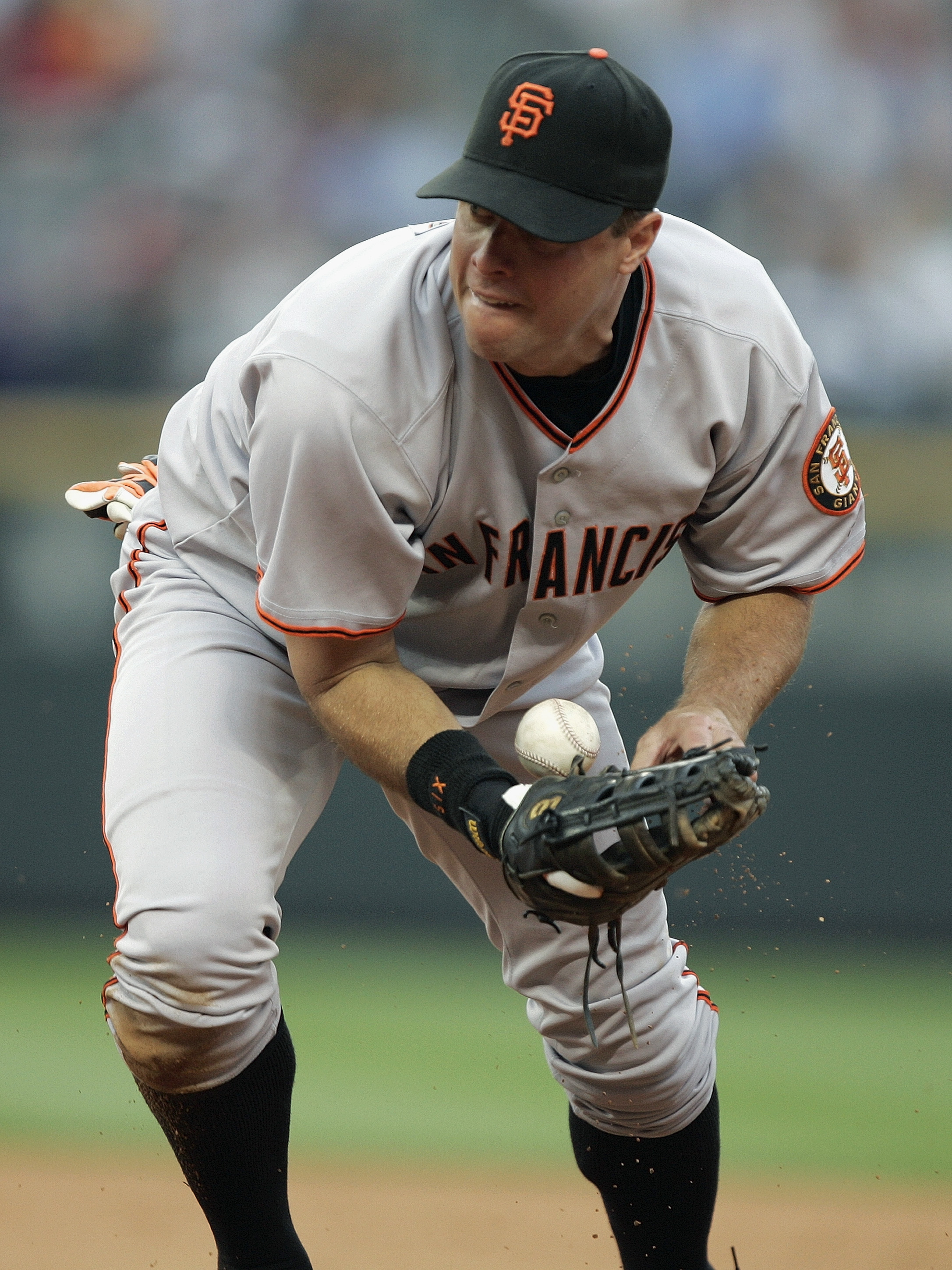 DENVER - JULY 17:  First baseman J.T. Snow #6 of the San Francisco Giants fields the ball during the game against the Colorado Rockies at Coors Field on July 17, 2004 in Denver, Colorado.  The Giants won 4-0. (Photo by Brian Bahr/Getty Images)