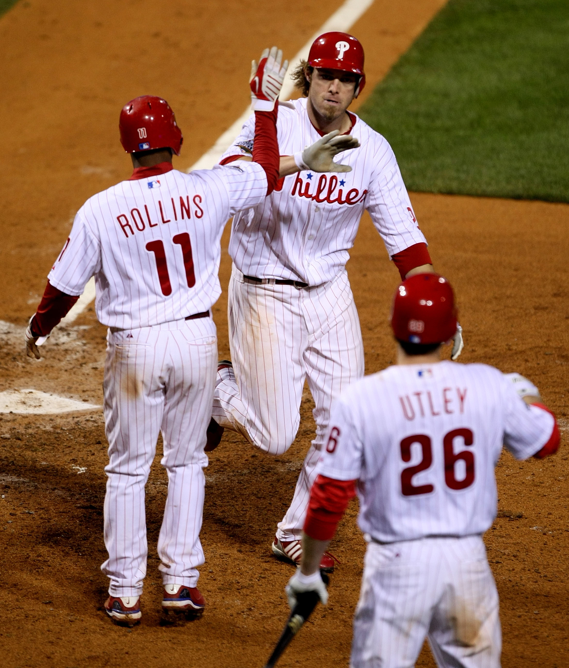 PHILADELPHIA - OCTOBER 26:  Jayson Werth #28 of the Philadelphia Phillies celebrates with Jimmy Rollins #11 and Chase Utley #26 after hitting a two-run home run against the Tampa Bay Rays during game four of the 2008 MLB World Series on October 26, 2008 a