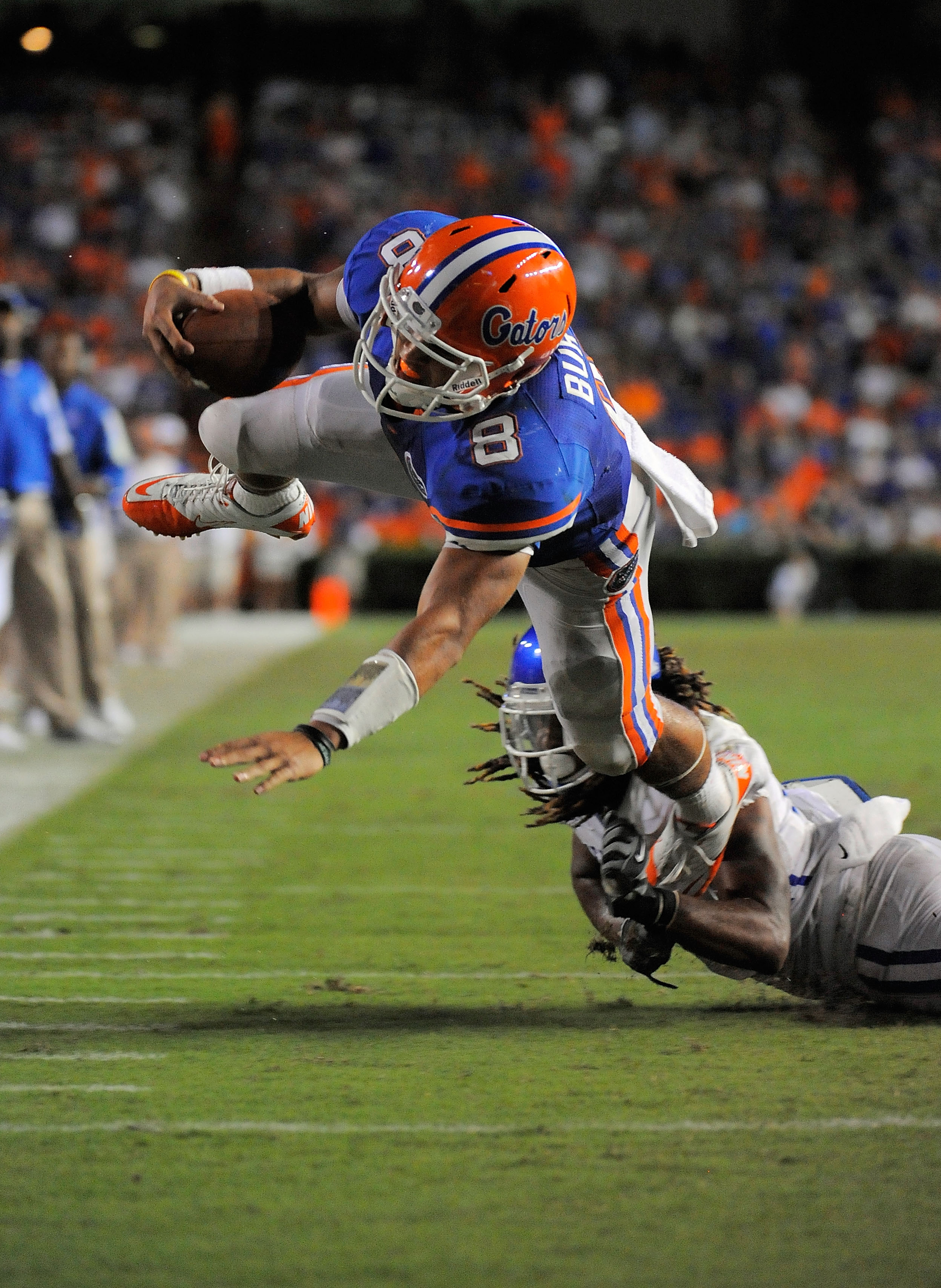 GAINESVILLE, FL - SEPTEMBER 25:  Quarterback Trey Burton #8 of the Florida Gators scores a touchdown as he is brought down by safety Winston Guy Jr. #21 of the Kentucky Wildcats at Ben Hill Griffin Stadium on September 25, 2010 in Gainesville, Florida. Fl