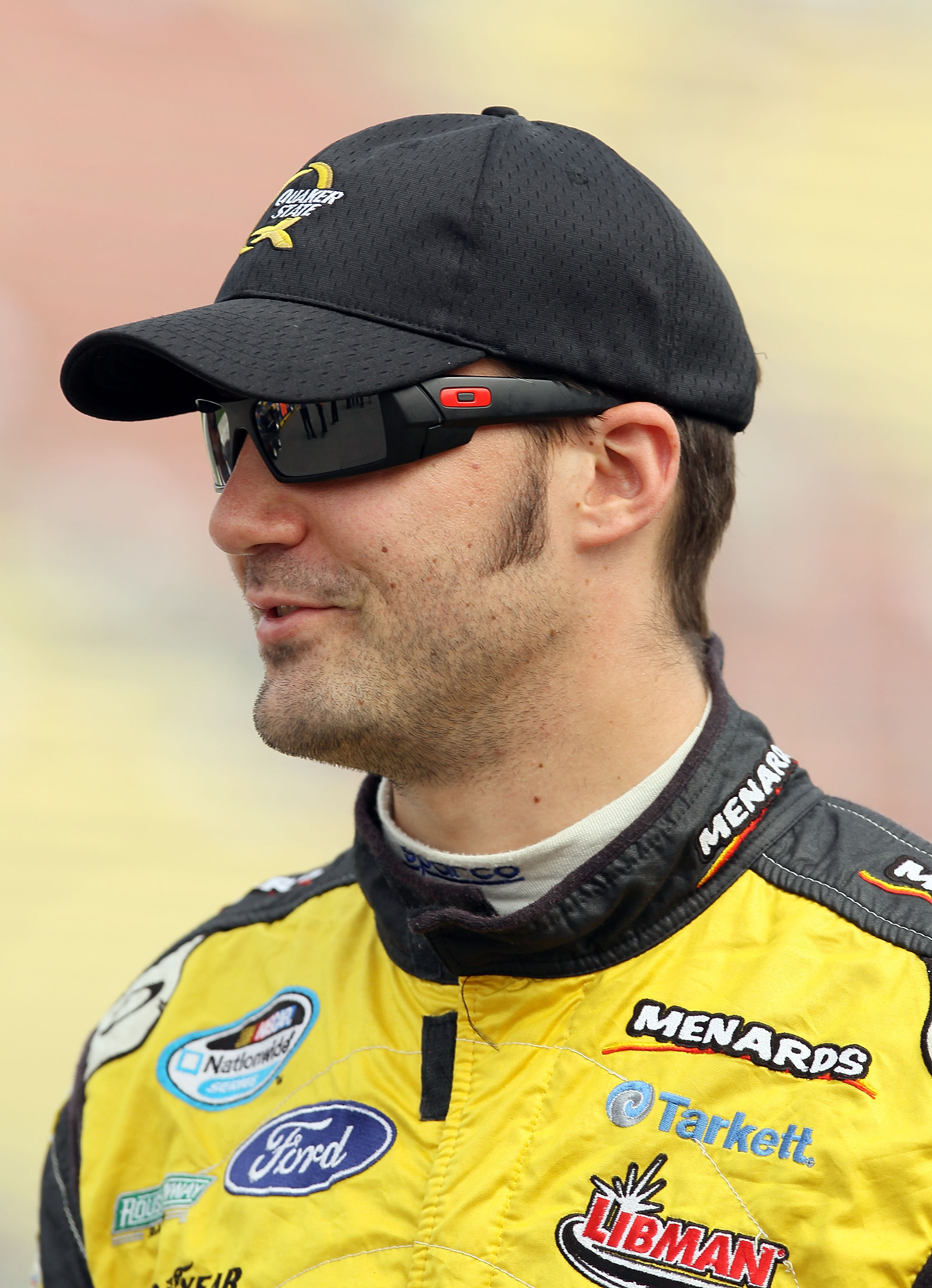 BROOKLYN, MI - AUGUST 14:  Paul Menard, driver of #98 the Richmond / Menards, looks on during qualifying for the NASCAR Nationwide Series CARFAX 250 at Michigan International Speedway on August 14, 2010 in Brooklyn, Michigan.  (Photo by Elsa/Getty Images)