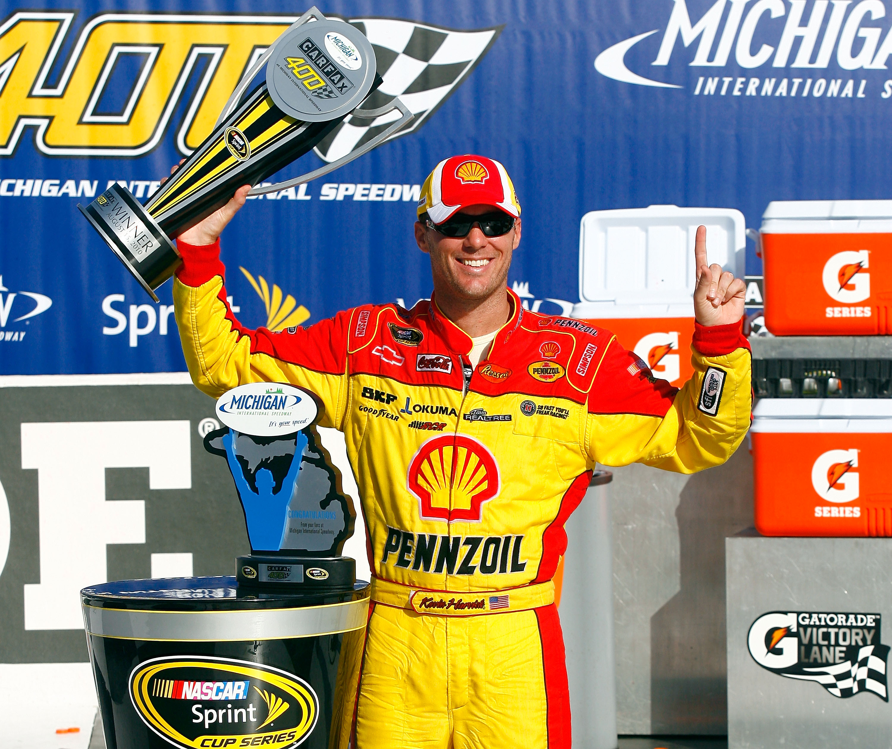 BROOKLYN, MI - AUGUST 15:  Kevin Harvick, driver of the #29 Shell/Pennzoil Chevrolet, celebrates with the trophy in victory lane after winning the NASCAR Sprint Cup Series CARFAX 400 at Michigan International Speedway on August 15, 2010 in Brooklyn, Michi