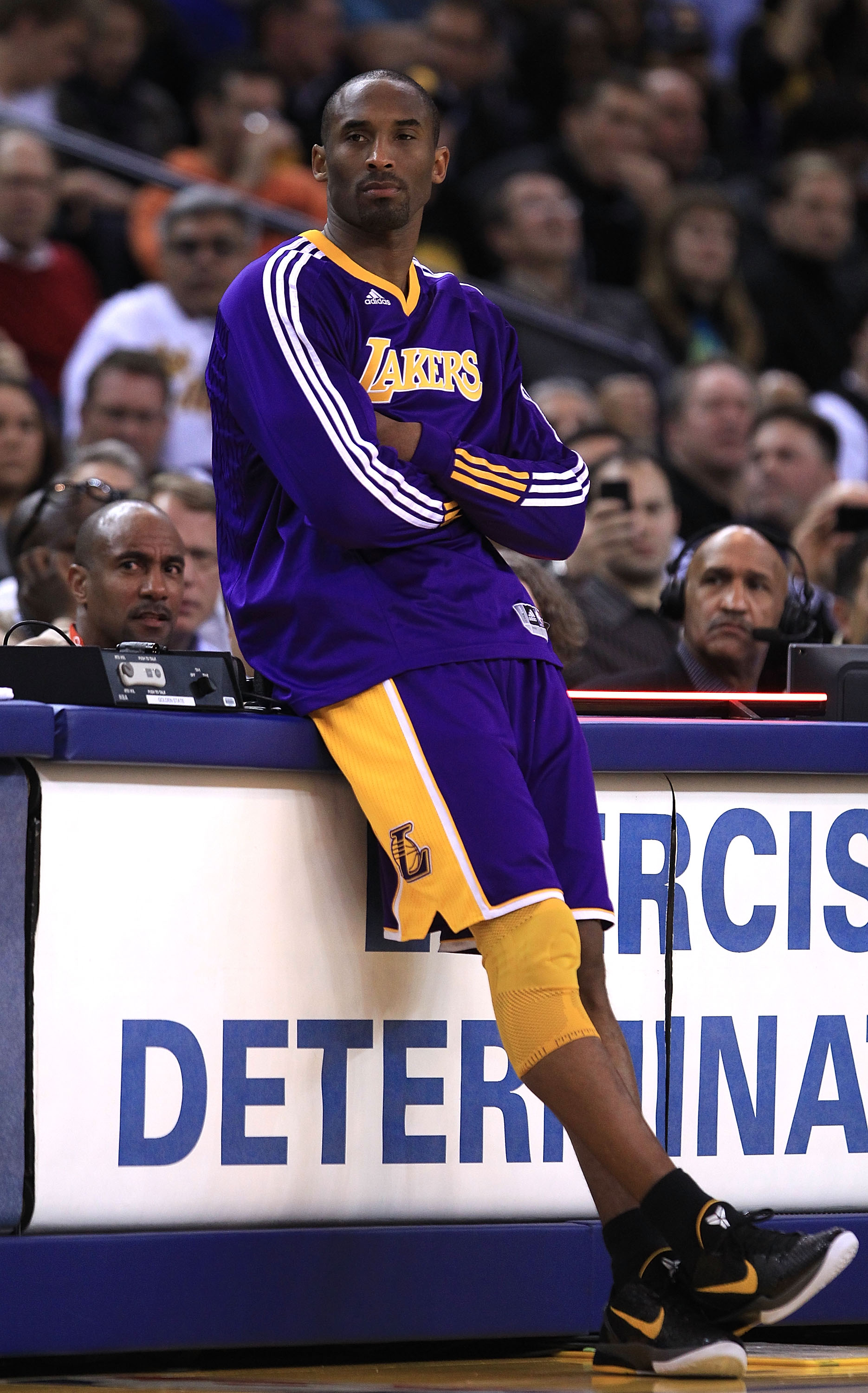 OAKLAND, CA - JANUARY 12:  Kobe Bryant #24 of the Los Angeles Lakers waits to come in to the game during their game against the Golden State Warriors at Oracle Arena on January 12, 2011 in Oakland, California. NOTE TO USER: User expressly acknowledges and