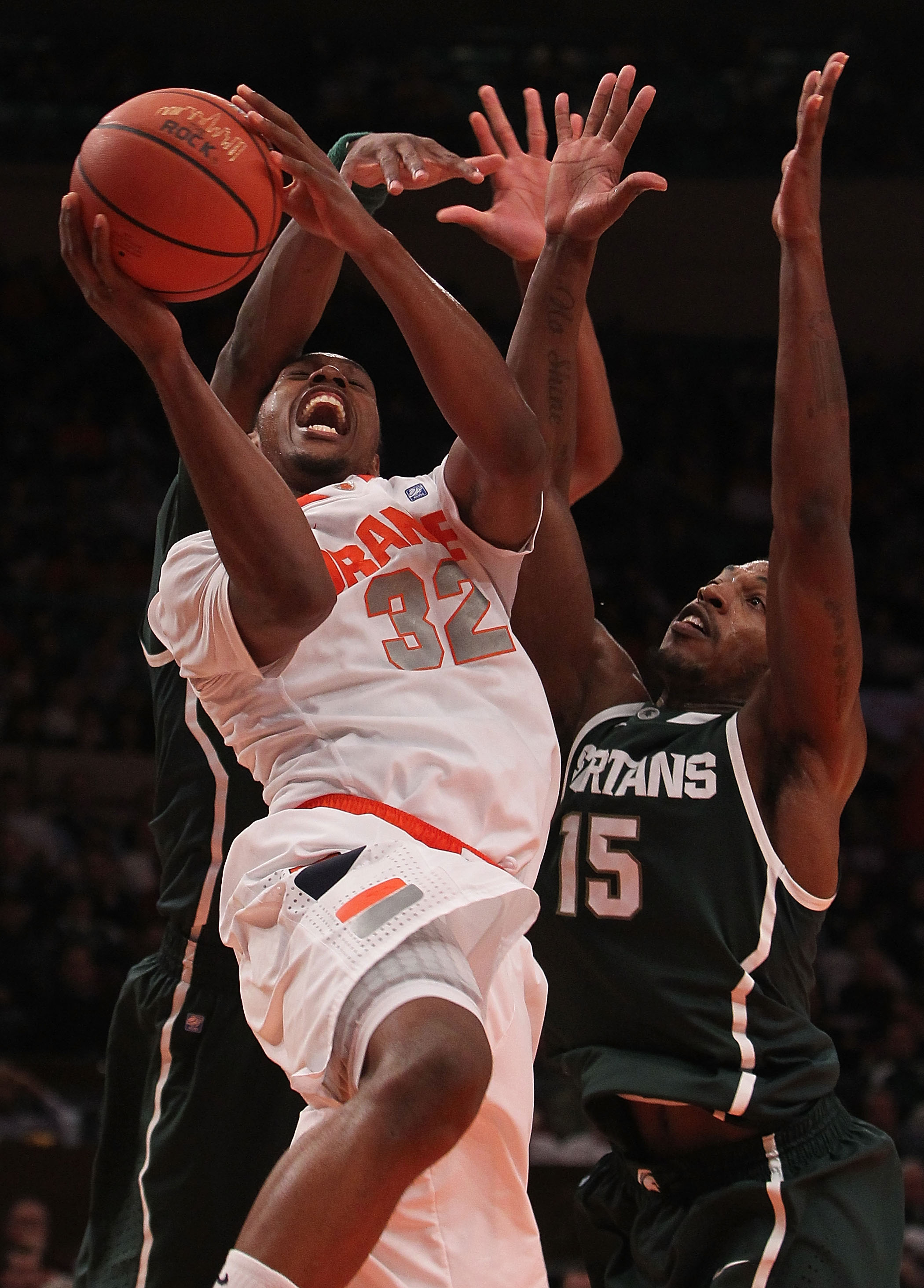 NEW YORK, NY - DECEMBER 07:  Kris Joseph #32 of Syracuse Orange is fouled against the Michigan State Spartans during their game at the Jimmy V Classic at Madison Square Garden on December 7, 2010 in New York City.  (Photo by Nick Laham/Getty Images)