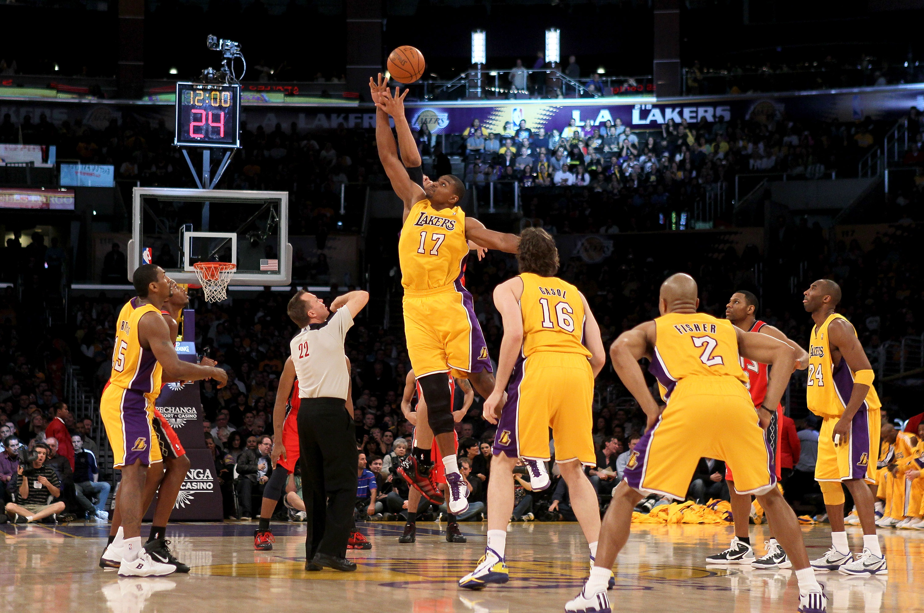 LOS ANGELES, CA - JANUARY 14:  Andrew Bynum #17 of the Los Angeles Lakers jumps for the ball on the opening tip off of the game with the New Jersey Nets at Staples Center on January 14, 2011 in Los Angeles, California. The Lakers won 100-88.  NOTE TO USER