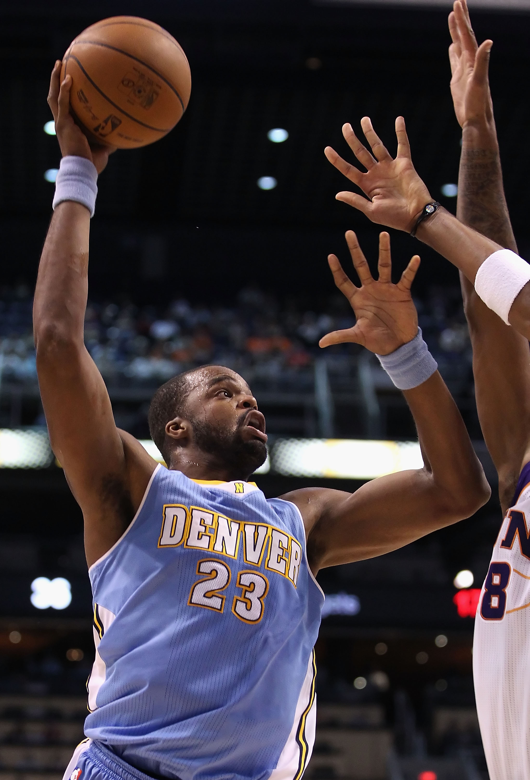 PHOENIX - OCTOBER 22:  Shelden Williams #23 of the Denver Nuggets puts up a shot against the Phoenix Suns during the preseason NBA game at US Airways Center on October 22, 2010 in Phoenix, Arizona. NOTE TO USER: User expressly acknowledges and agrees that