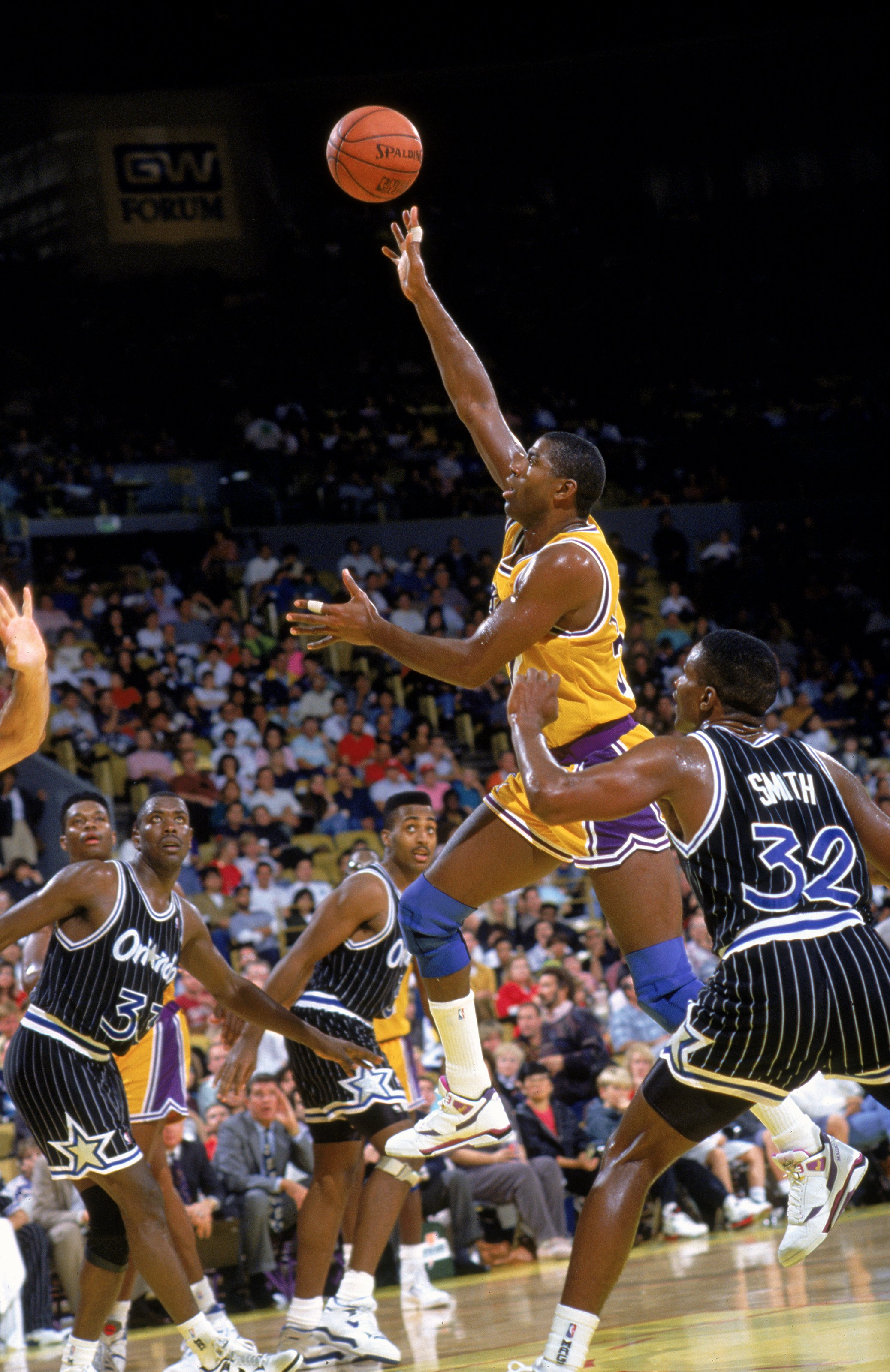1990: Magic Johnson #32 of the Los Angeles Lakers makes a lay-up during a game against the Orlando Magic.   Mandatory Credit: Stephen Dunn  /Allsport