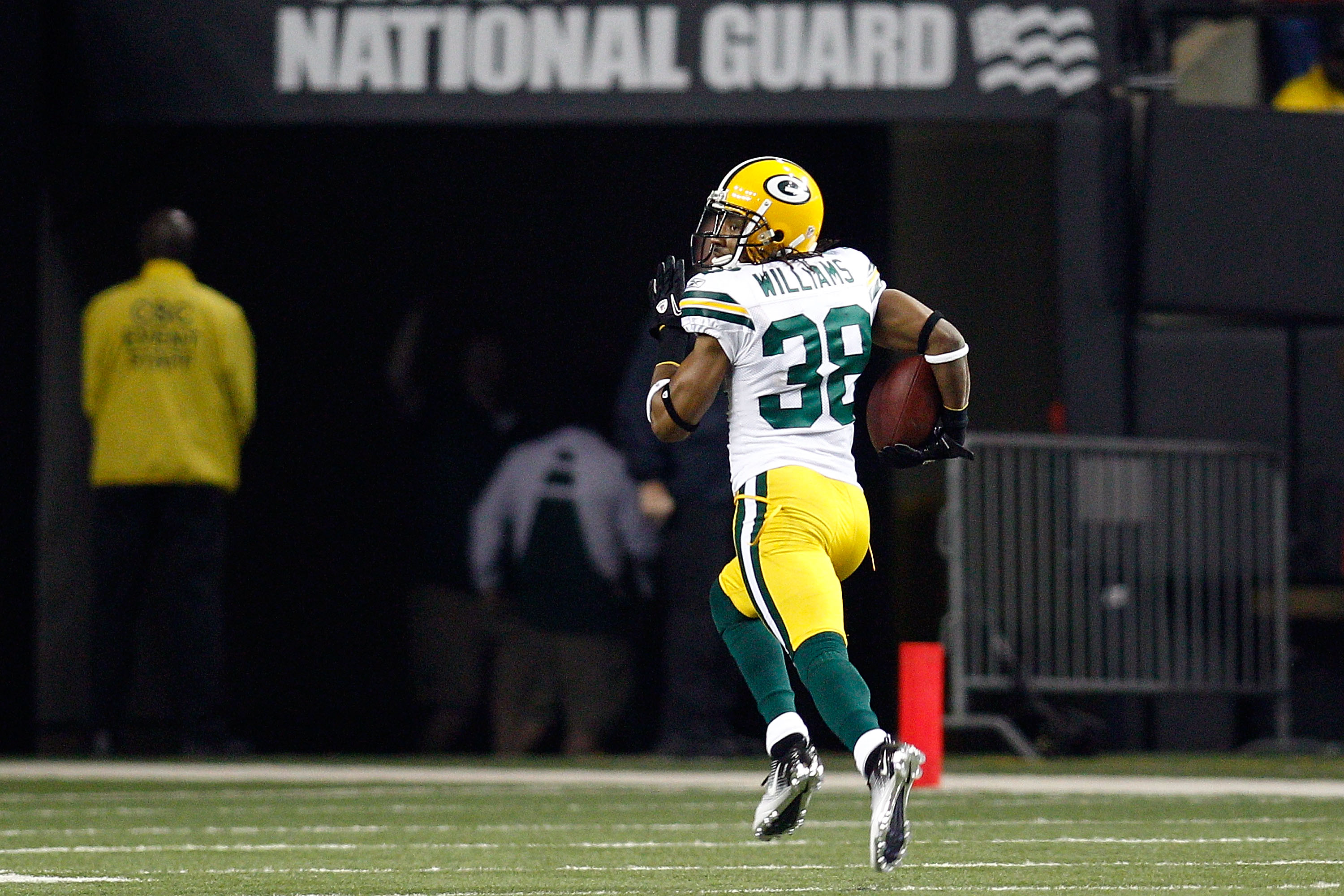 ATLANTA, GA - JANUARY 15:  Tramon Williams ##8 of the Green Bay Packers returns an interception 70-yards for a touchdown in the second quarter against the Atlanta Falcons during their 2011 NFC divisional playoff game at Georgia Dome on January 15, 2011 in