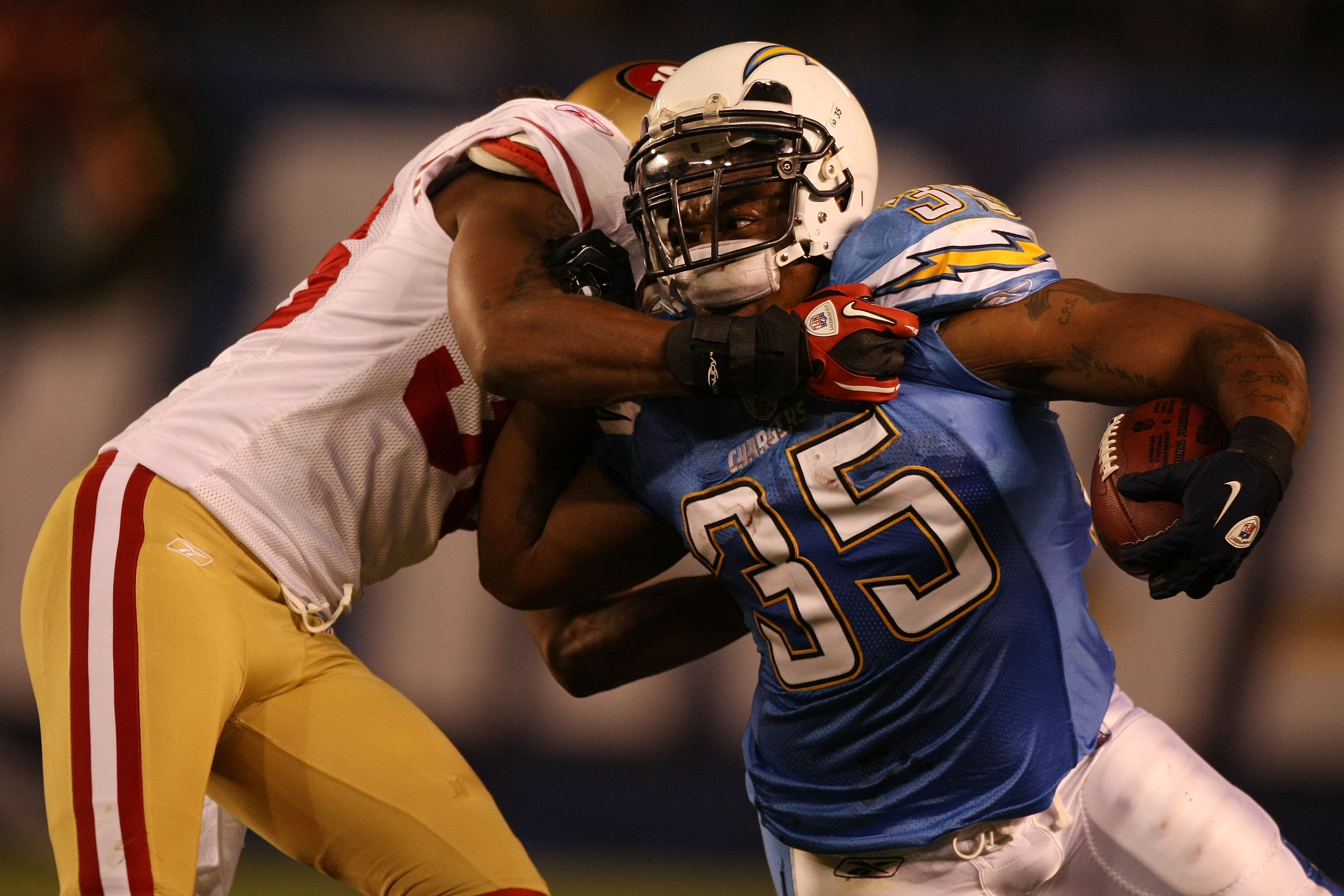 SAN DIEGO, CA - DECEMBER 16:  Running back Mike Tolbert #35 of the San Diego Chargers rushes with the ball as cornerback Shawntae Spencer #36 of the San Francisco 49ers trys to tackle him at Qualcomm Stadium on December 16, 2010 in San Diego, California.