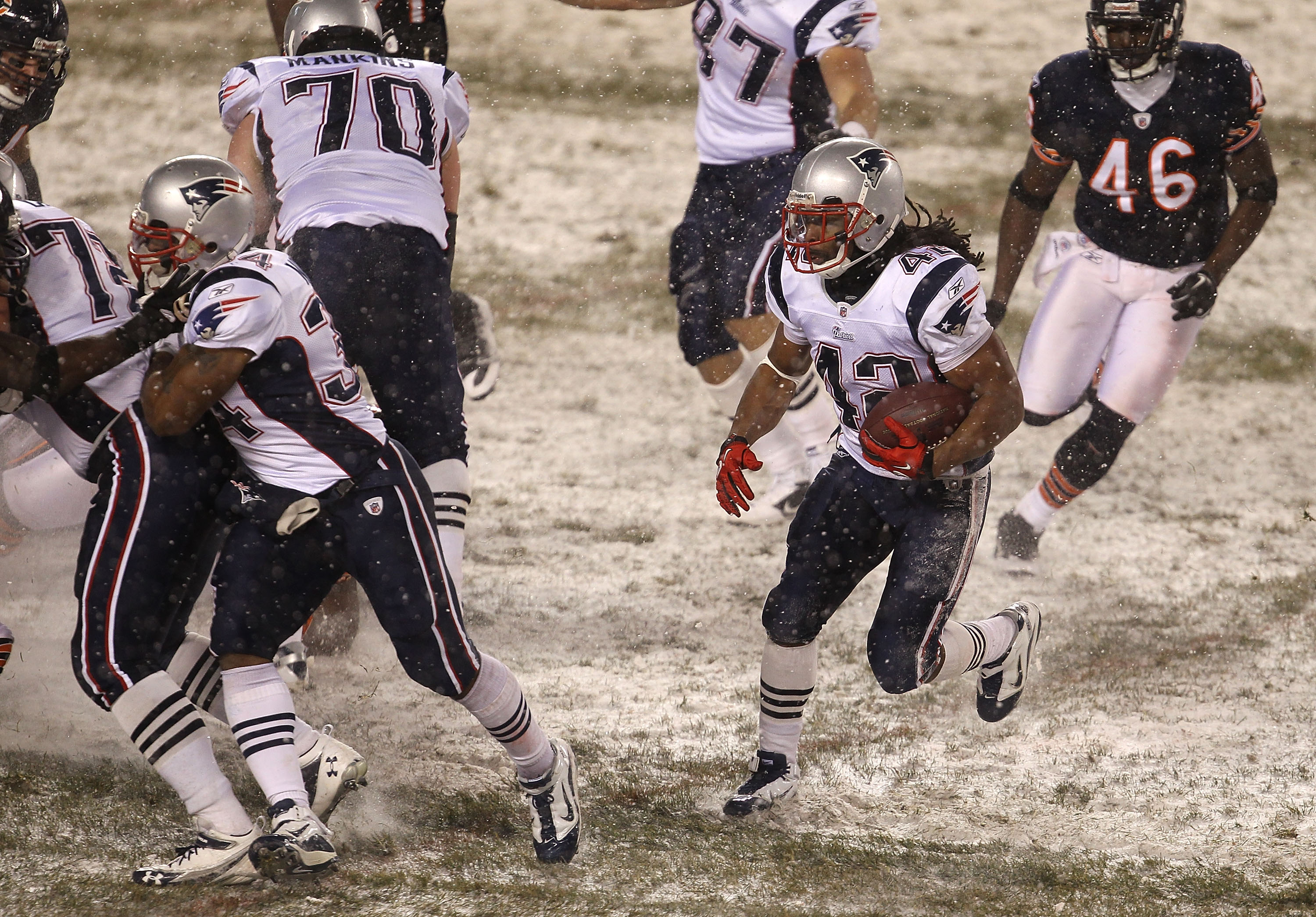 CHICAGO, IL - DECEMBER 12: Ben-Jarvus Green-Ellis #42 of the New England Patriots looks for running room pursued by Chris Harris #46 of the Chicago Bears at Soldier Field on December 12, 2010 in Chicago, Illinois. The Patriots defeated the Bears 36-7. (Ph