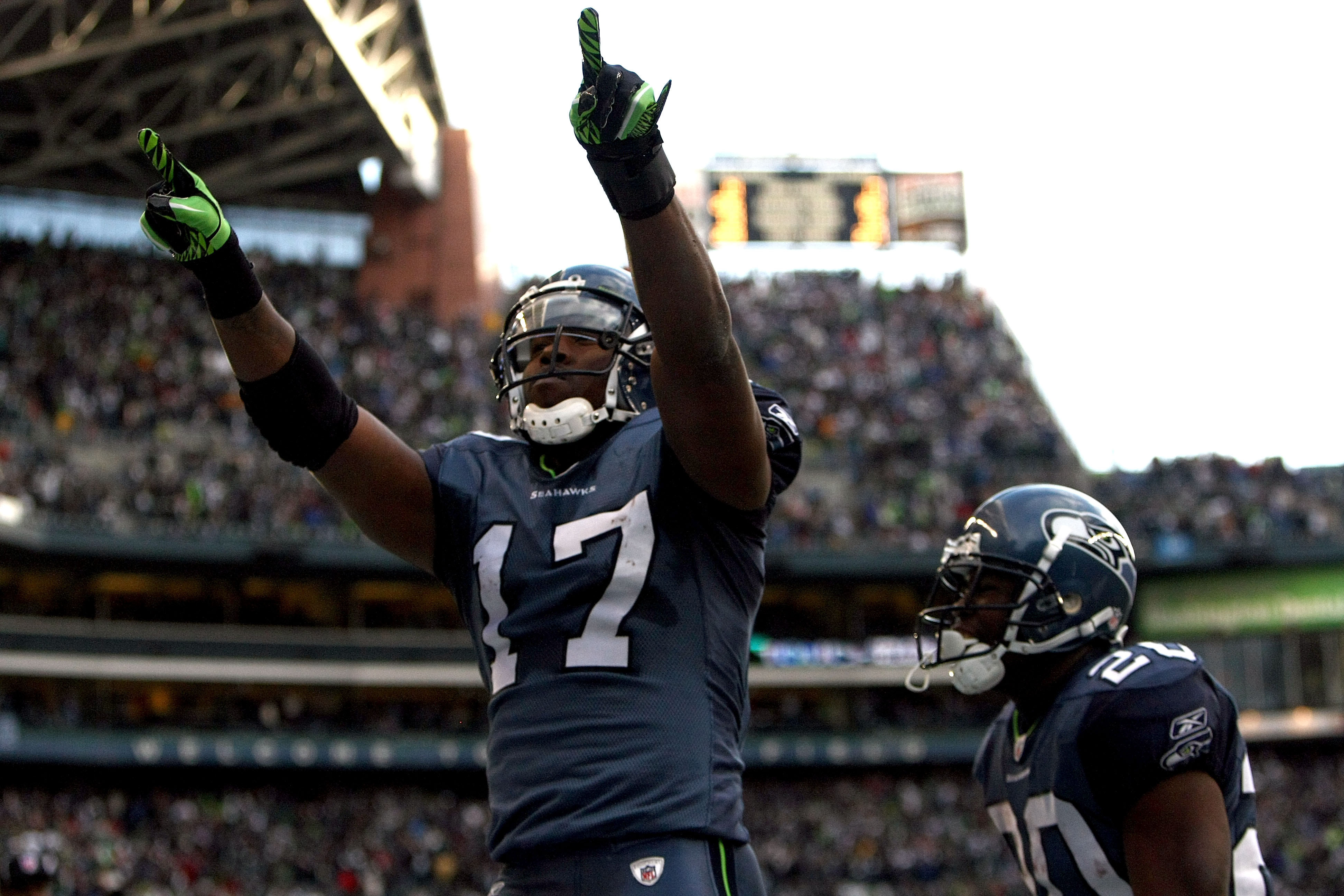 SEATTLE, WA - JANUARY 08:  Wide receiver Mike Williams #17 of the Seattle Seahawks reacts after catching a 38-yard third quarter touchdown pass against the New Orleans Saints during the 2011 NFC wild-card playoff game at Qwest Field on January 8, 2011 in