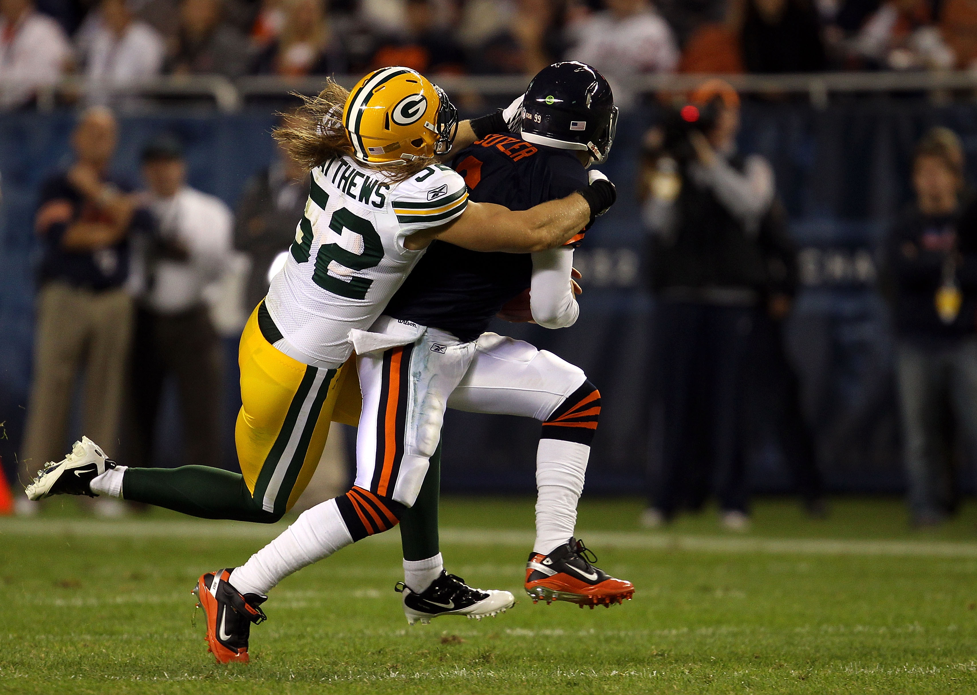 CHICAGO - SEPTEMBER 27:  Clay Matthews #52 of the Green Bay Packers is called for a facemask as he pulls down Jay Cutler #6 of the Chicago Bears in the first quarter at Soldier Field on September 27, 2010 in Chicago, Illinois. The Bears won 20-17. (Photo