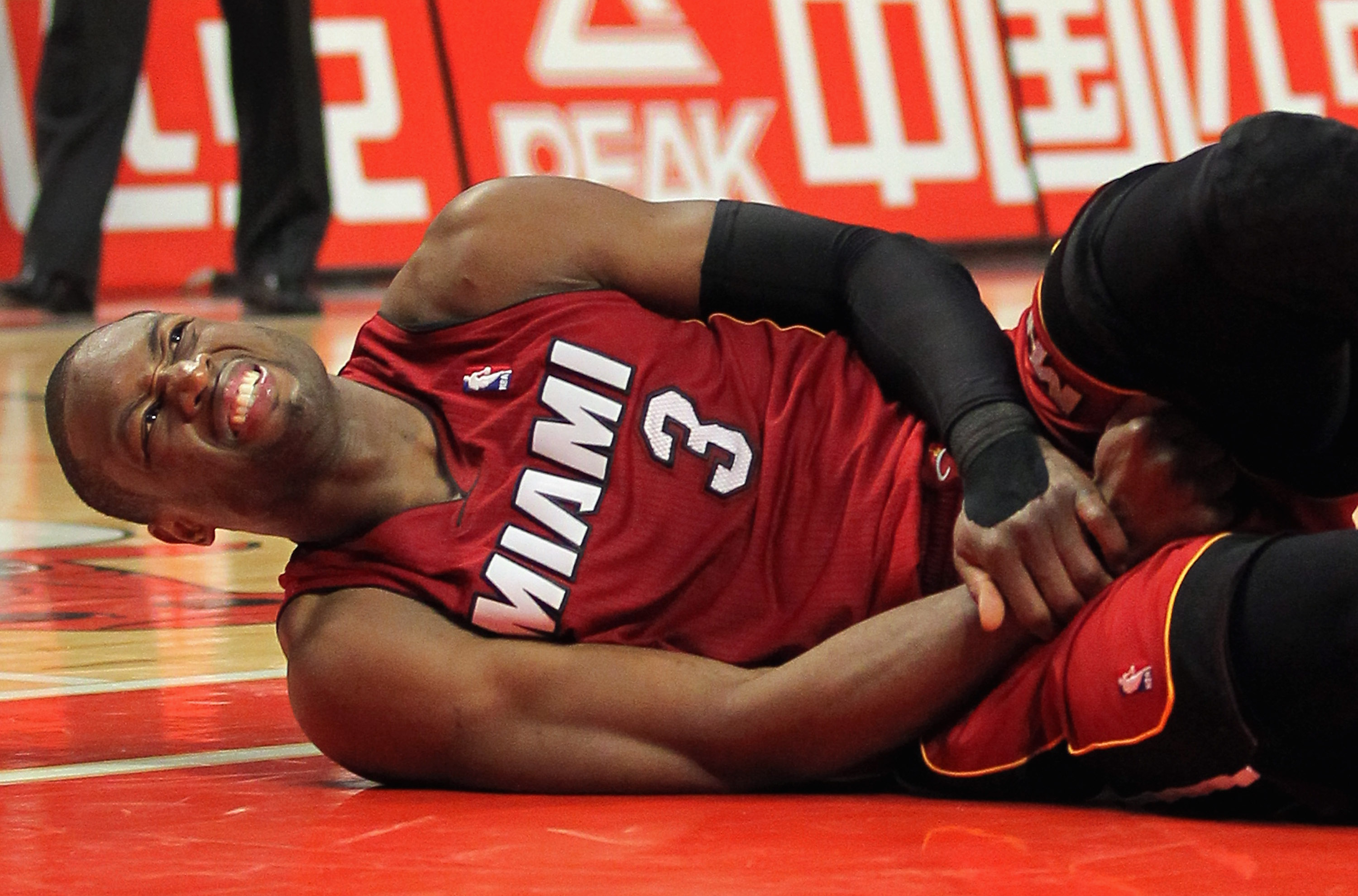 CHICAGO, IL - JANUARY 15:  Dwayne Wade #3 of the Miami Heat grimaces as he lies on the floor after being fouled by the Chicago Bulls at the United Center on January 15, 2011 in Chicago, Illinois. NOTE TO USER: User expressly acknowledges and agrees that,