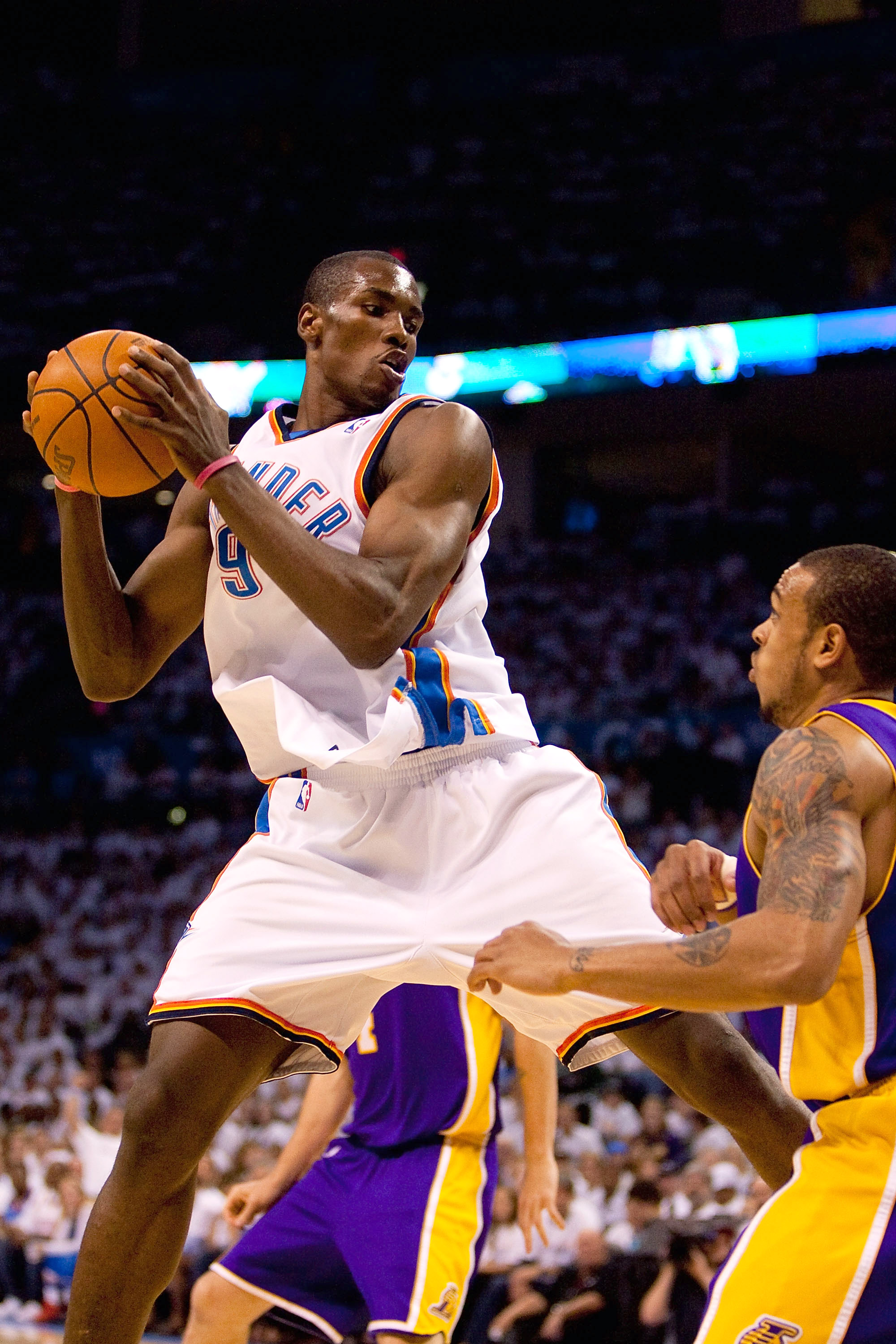OKLAHOMA CITY - APRIL 24: Serge Ibaka #9 of the Oklahoma City Thunder pulls down a rebound against the Los Angeles Lakers during Game Four of the Western Conference Quarterfinals of the 2010 NBA Playoffs on April 24, 2010 at the Ford Center in Oklahoma Ci
