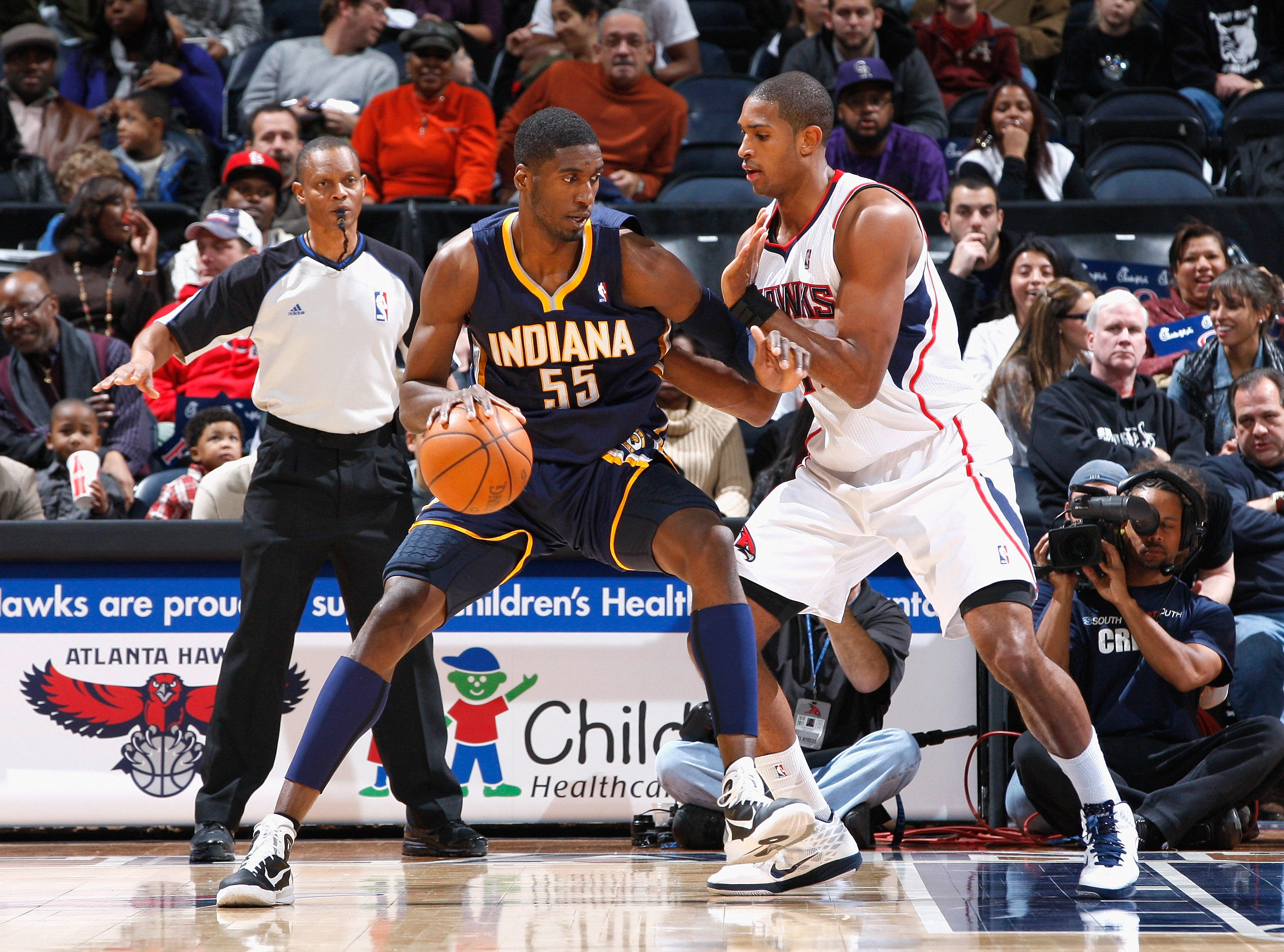 ATLANTA, GA - DECEMBER 11:  Roy Hibbert #55 of the Indiana Pacers against Al Horford #15 of the Atlanta Hawks at Philips Arena on December 11, 2010 in Atlanta, Georgia.  NOTE TO USER: User expressly acknowledges and agrees that, by downloading and/or usin