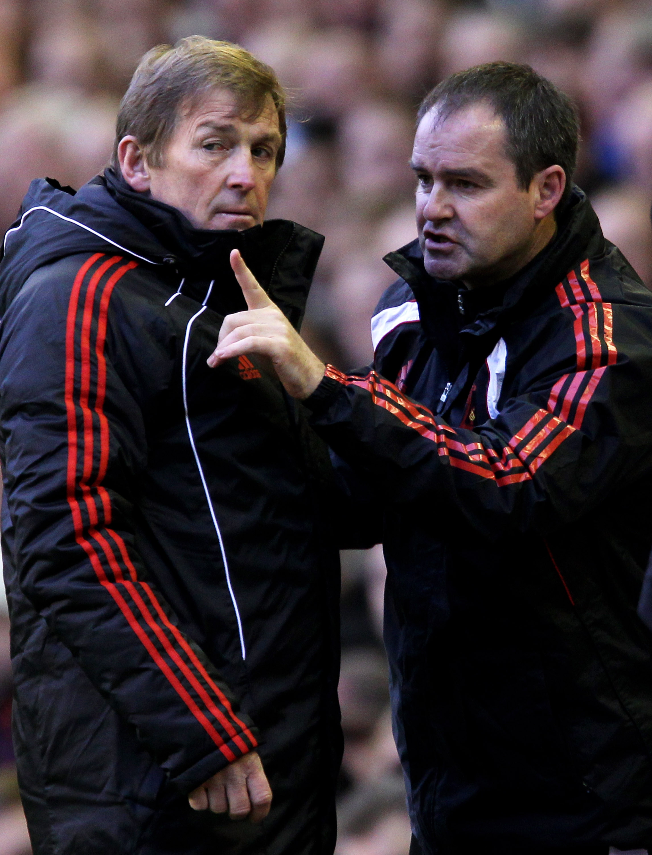 LIVERPOOL, ENGLAND - JANUARY 16:  Liverpool Manager Kenny Dalglish issues instructions with Head Coach Steve Clarke (R) prior to the Barclays Premier League match between Liverpool and Everton at Anfield on January 16, 2011 in Liverpool, England.  (Photo