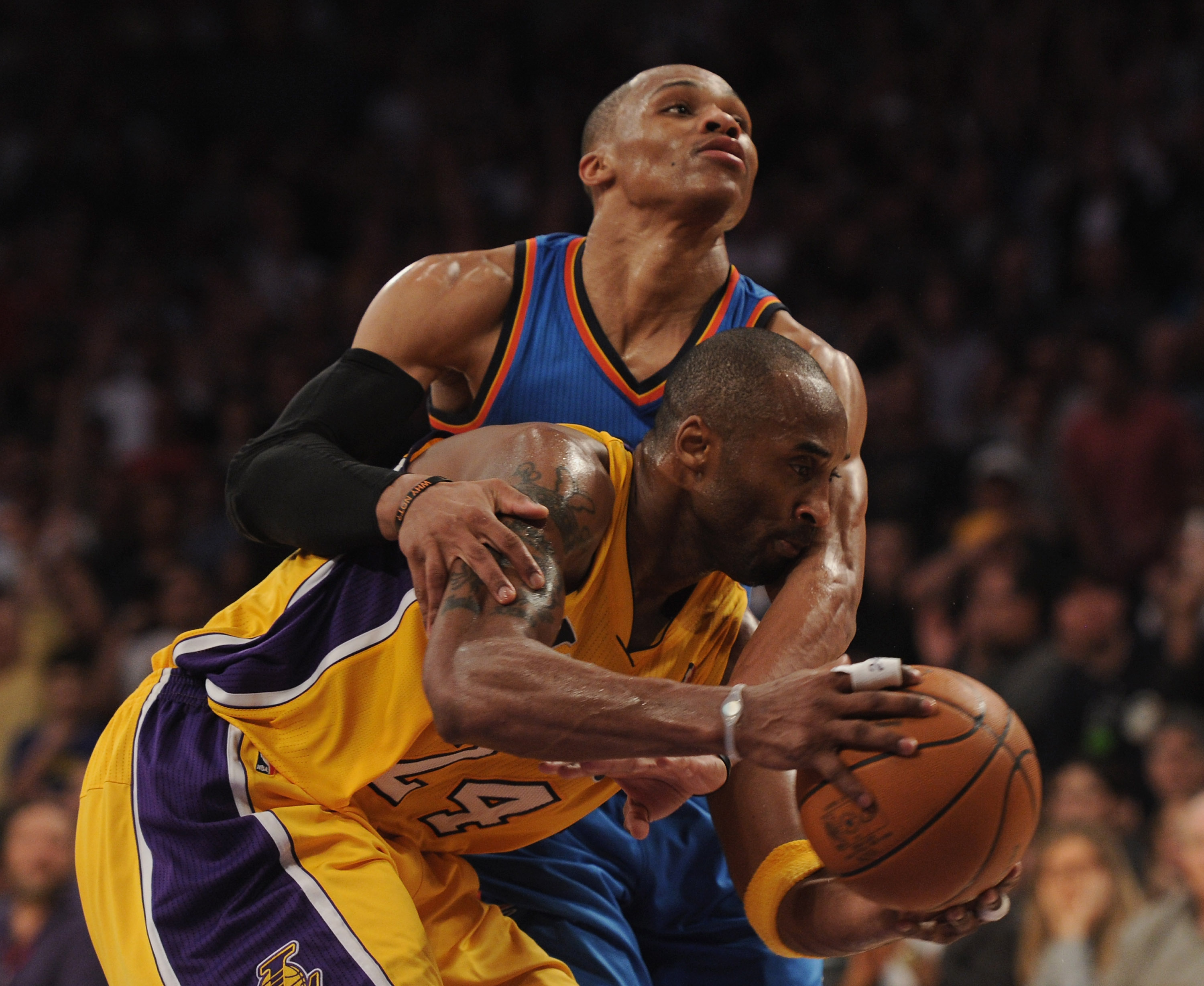 LOS ANGELES, CA - JANUARY 17:  Kobe Bryant #24 of the Los Angeles Lakers is fouled by Russell Westbrook #0 of the Oklahoma City Thunder during a 101-94 Laker win at the Staples Center on January 17, 2011 in Los Angeles, California.   NOTE TO USER: User ex