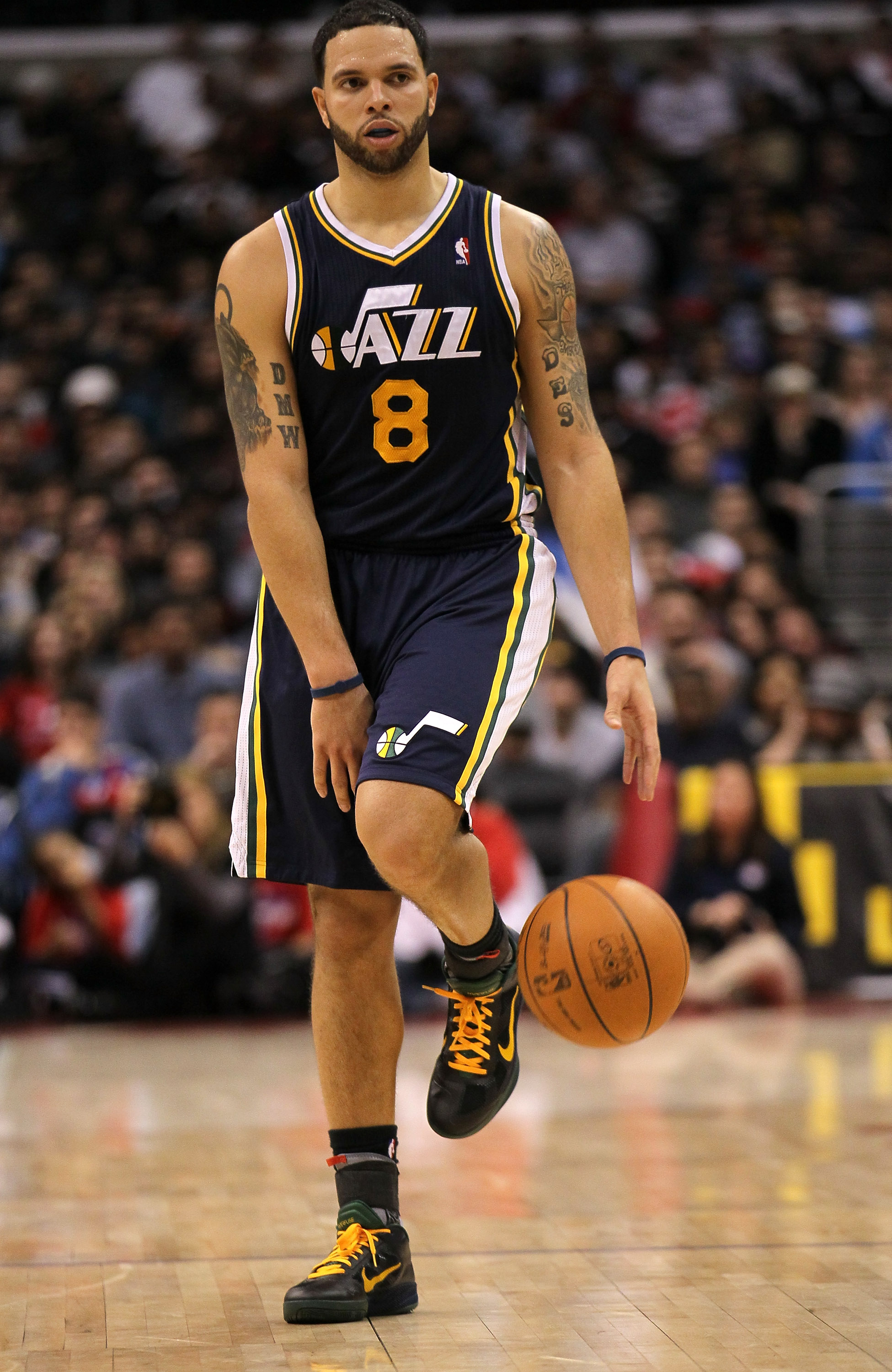 LOS ANGELES, CA - DECEMBER 29:  Deron Williams #8 of the Utah Jazz controls the ball against the Los Angeles Clippers at Staples Center on December 29, 2010 in Los Angeles, California.   The Jazz won 103-85.  NOTE TO USER: User expressly acknowledges and