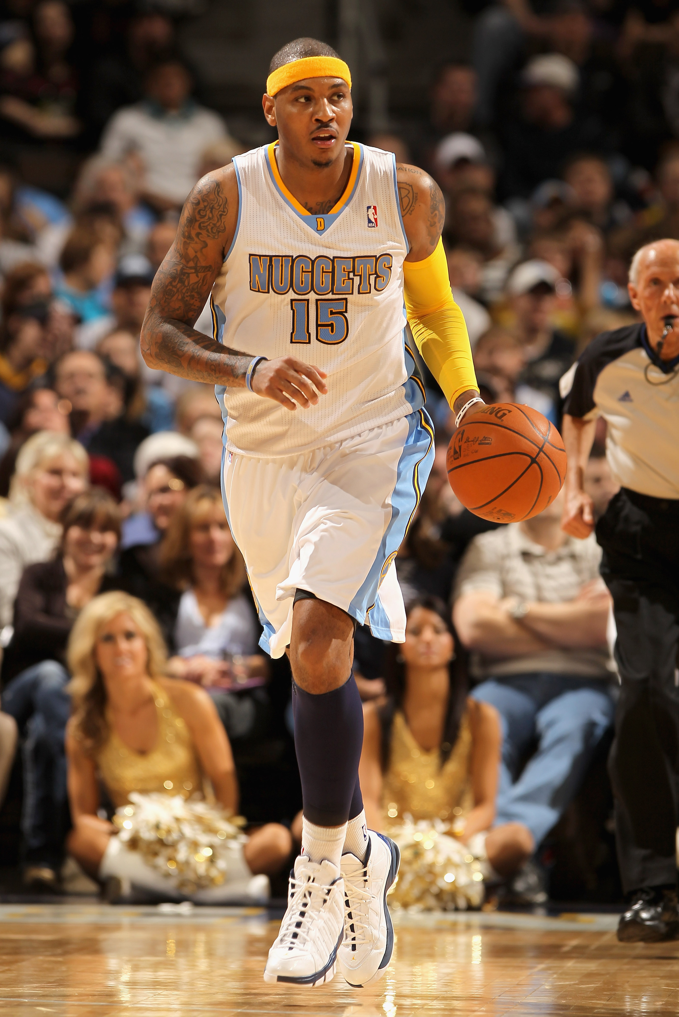 DENVER, CO - JANUARY 13:  Carmelo Anthony #15 of the Denver Nuggets dribbles the ball upcourt against the Miami Heat at the Pepsi Center on January 13, 2011 in Denver, Colorado. The Nuggets defeated the Heat 130-102. NOTE TO USER: User expressly acknowled