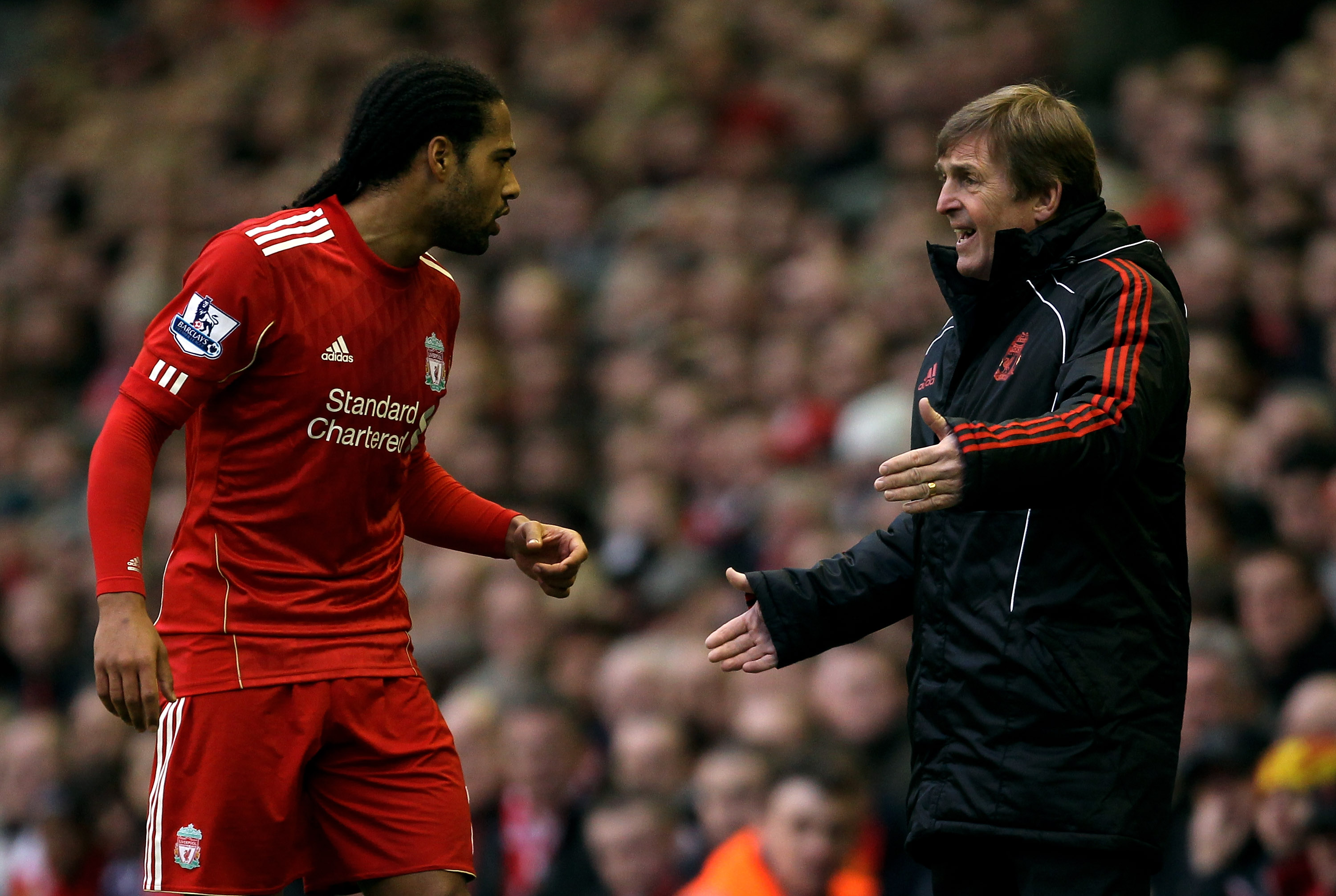 LIVERPOOL, ENGLAND - JANUARY 16:  Liverpool Manager Kenny Dalglish issues instructions to Glen Johnson during the Barclays Premier League match between Liverpool and Everton at Anfield on January 16, 2011 in Liverpool, England.  (Photo by Alex Livesey/Get