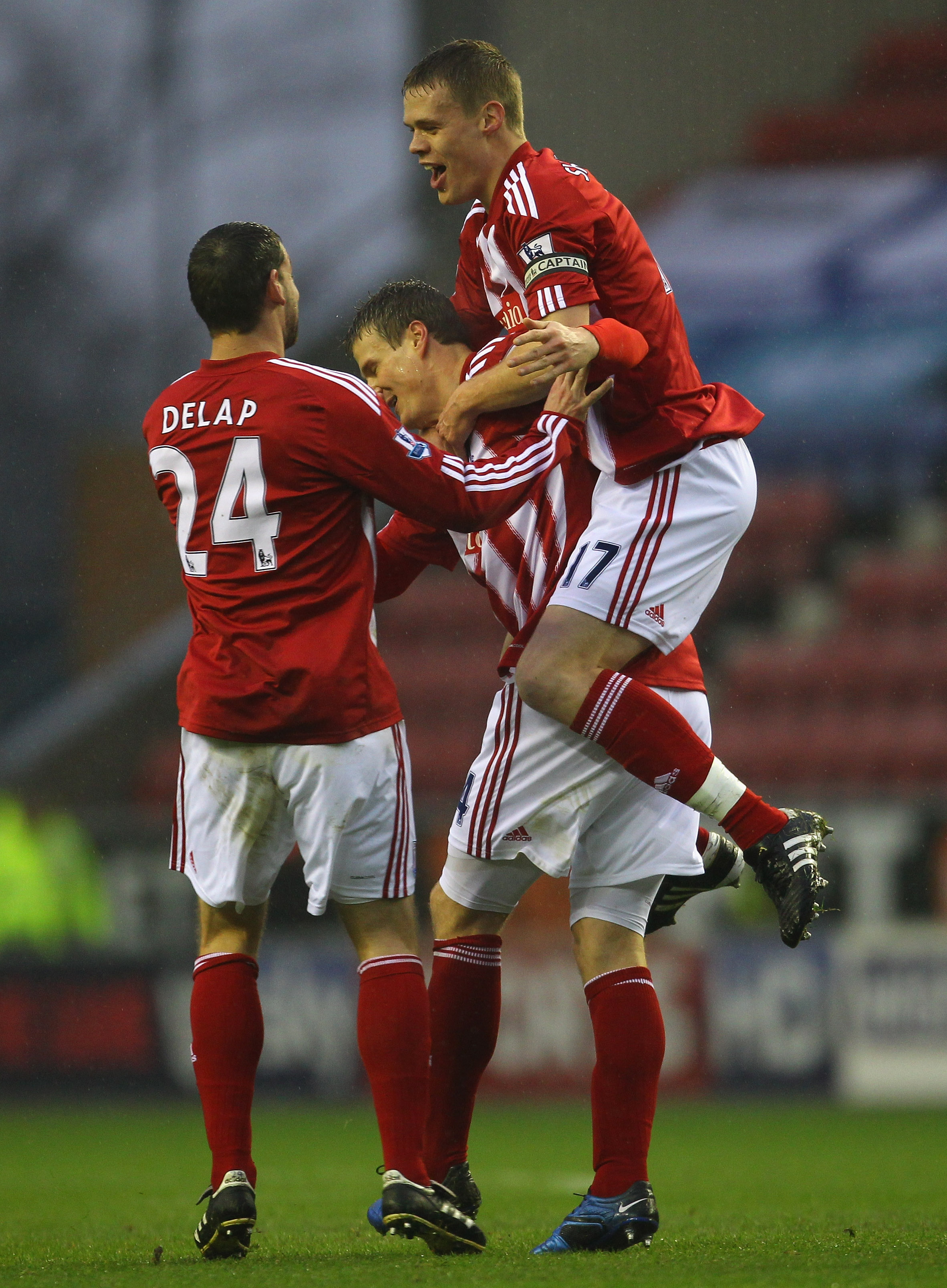 WIGAN, ENGLAND - DECEMBER 04:  Robert Huth of Stoke City is congratulated by Ryan Shawcross and Rory Delap after scoring the opening goal during the Barclays Premier League match between Wigan Athletic and Stoke City at DW Stadium on December 4, 2010 in W